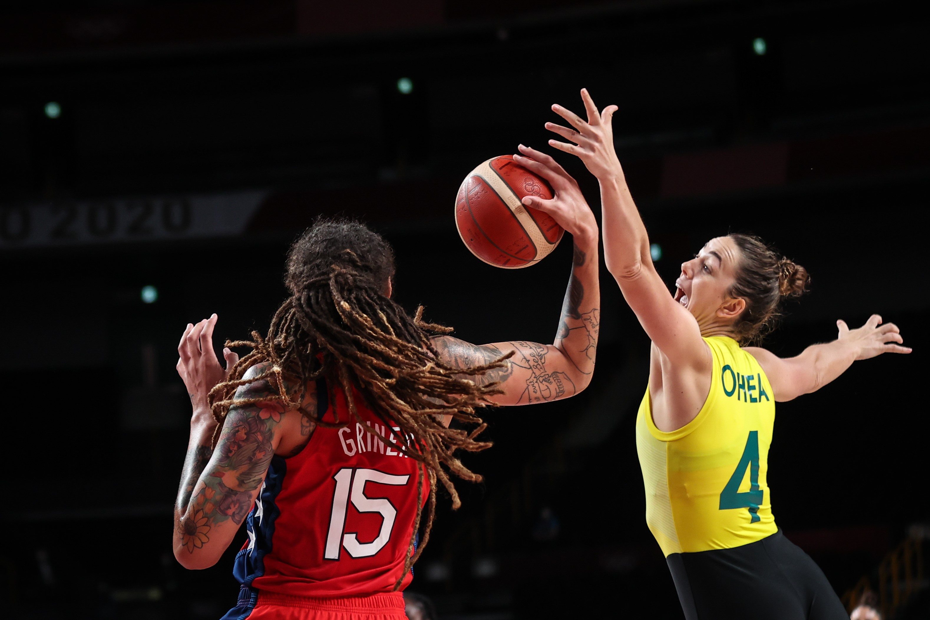 Brittney Griner L of the United States competes with Jenna O'Hea of Australia during the women's basketball quarterfinal between the United States and Australia at the Tokyo 2020 Olympic Games in Saitama, Japan, Aug. 4, 2021.