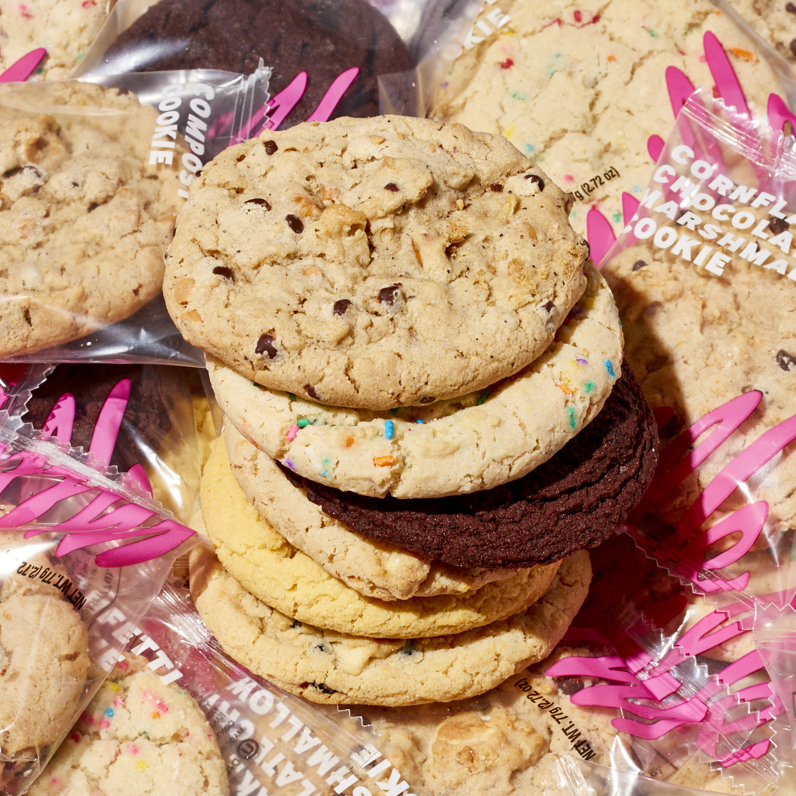 A stack of cookies sit on Milk Bar branded bags.