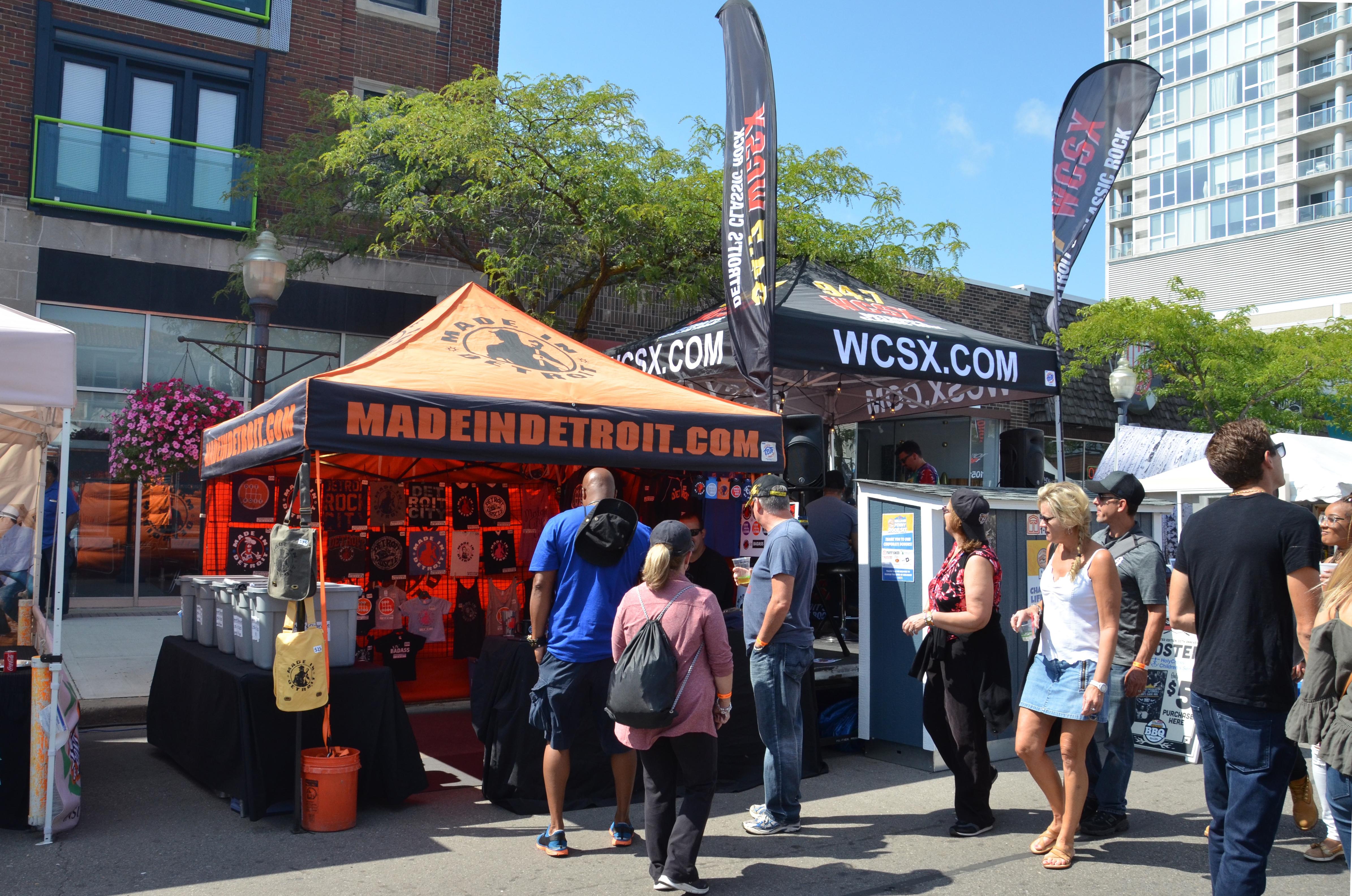 Festival goers outside food tents at Arts, Beats & Eats