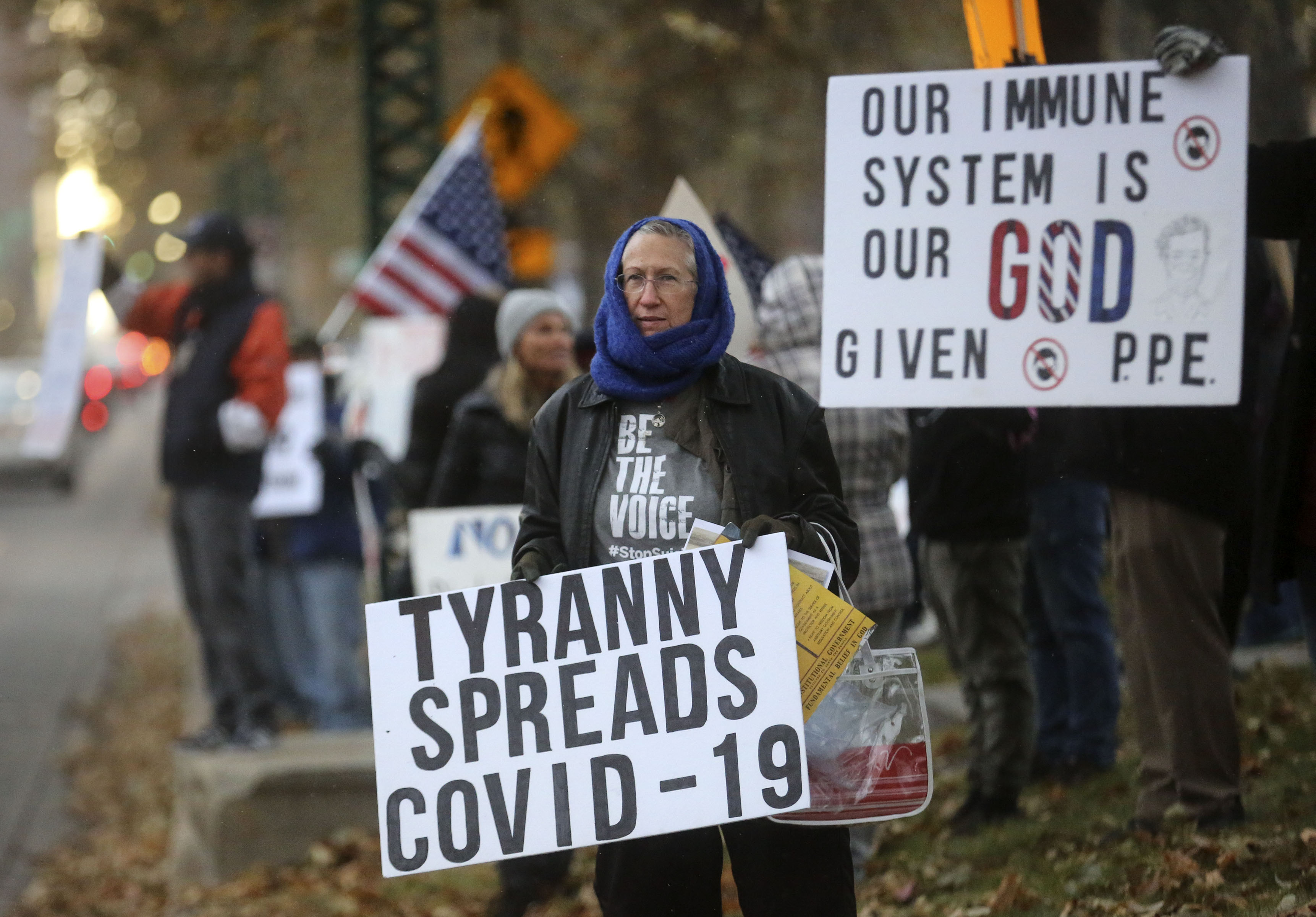 Protesters gather outside of the Governor's Mansion to protest Gov. Gary Herbert's mask mandate and new COVID-19 restrictions in Salt Lake City on Monday, Nov. 9, 2020.