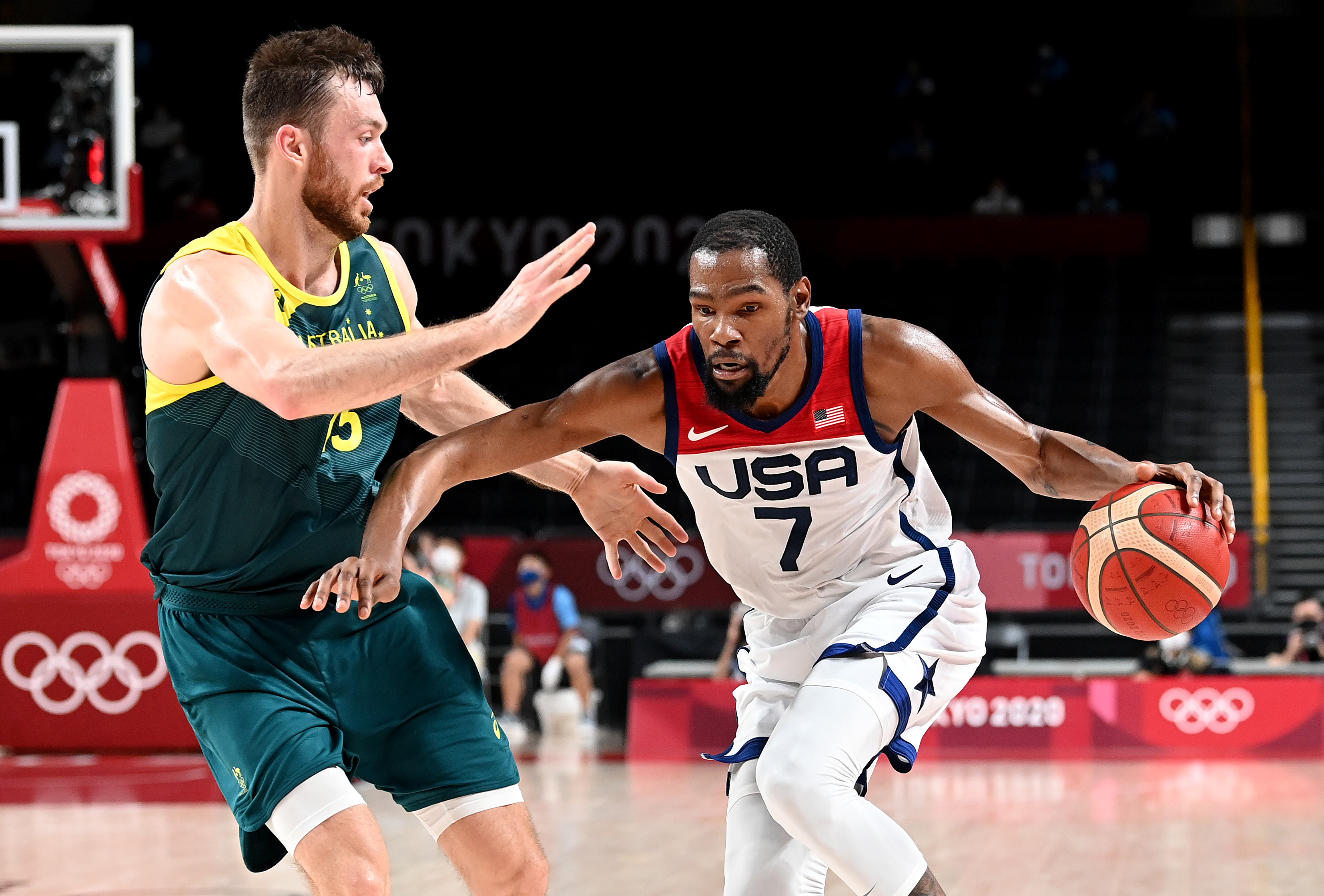 Kevin Durant of the USA takes on the defence of Nic Kay of Australia during the Basketball semi final match between Australia and the USA on day thirteen of the Tokyo 2020 Olympic Games at Saitama Super Arena on August 05, 2021 in Saitama, Japan.