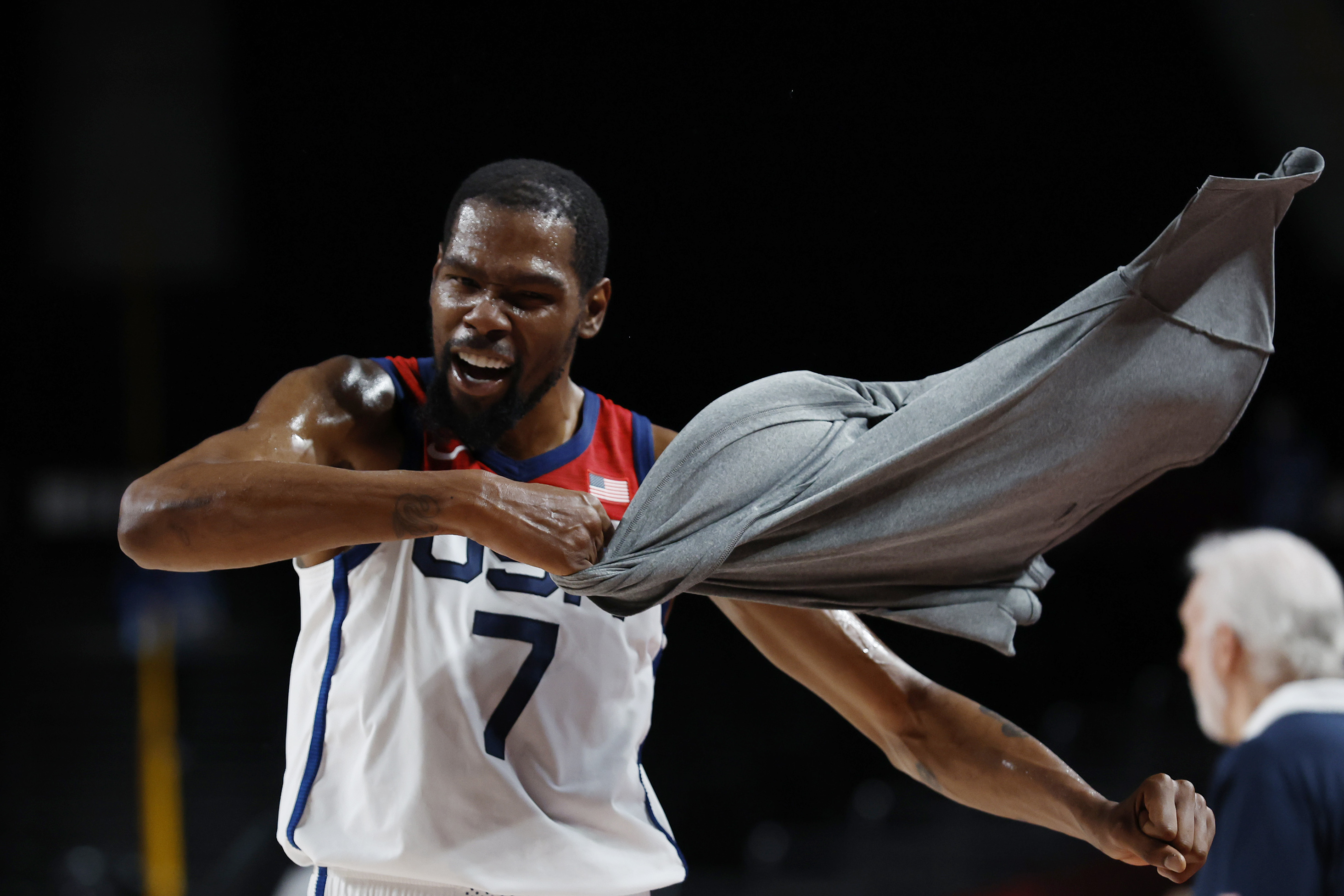 United States forward Kevin Durant (7) celebrates on the bench against Australia in the third quarter during the Tokyo 2020 Olympic Summer Games at Saitama Super Arena.