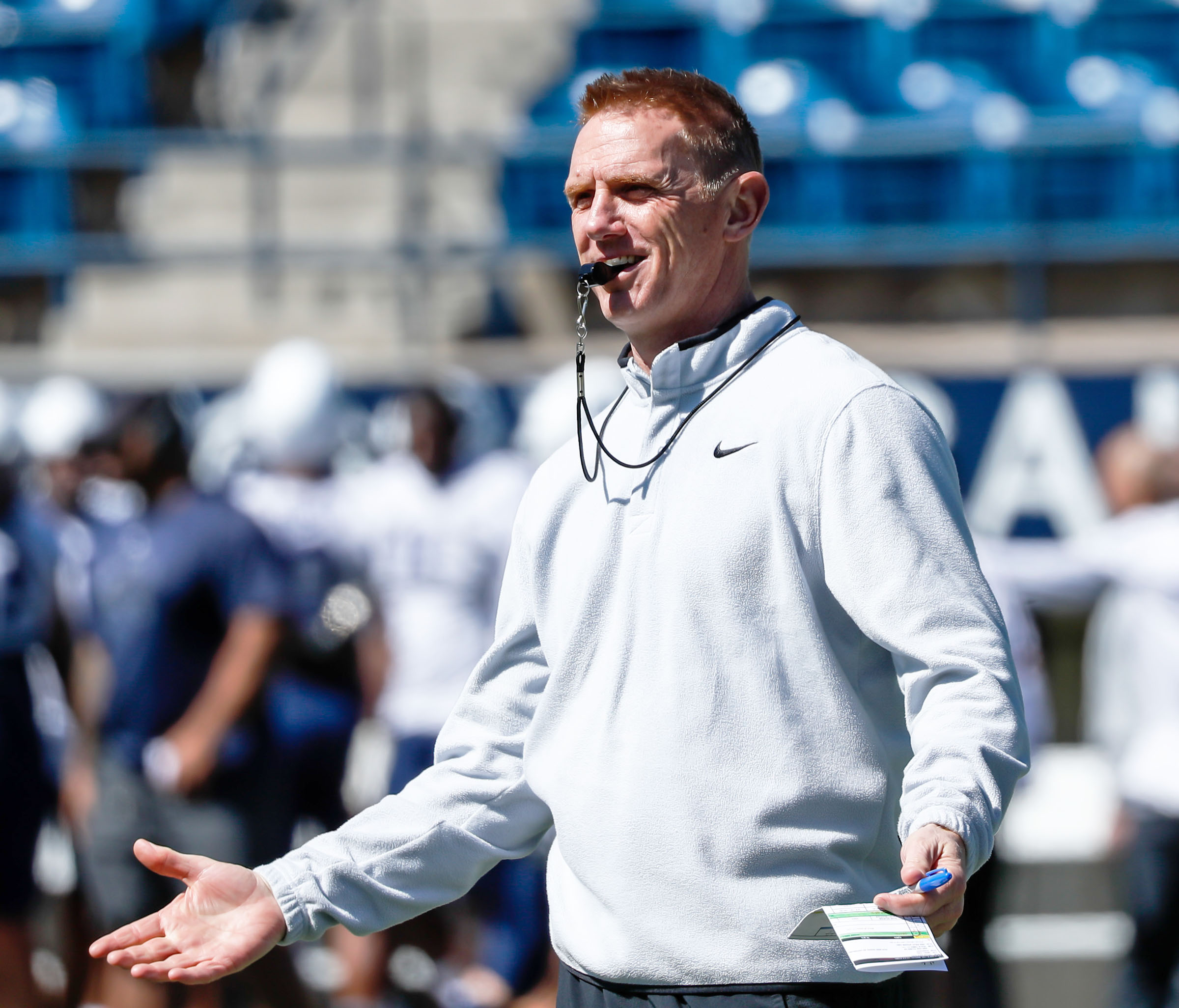 Blake Anderson coaches the USU football team during a spring football scrimmage at Maverik Stadium in April 2021.