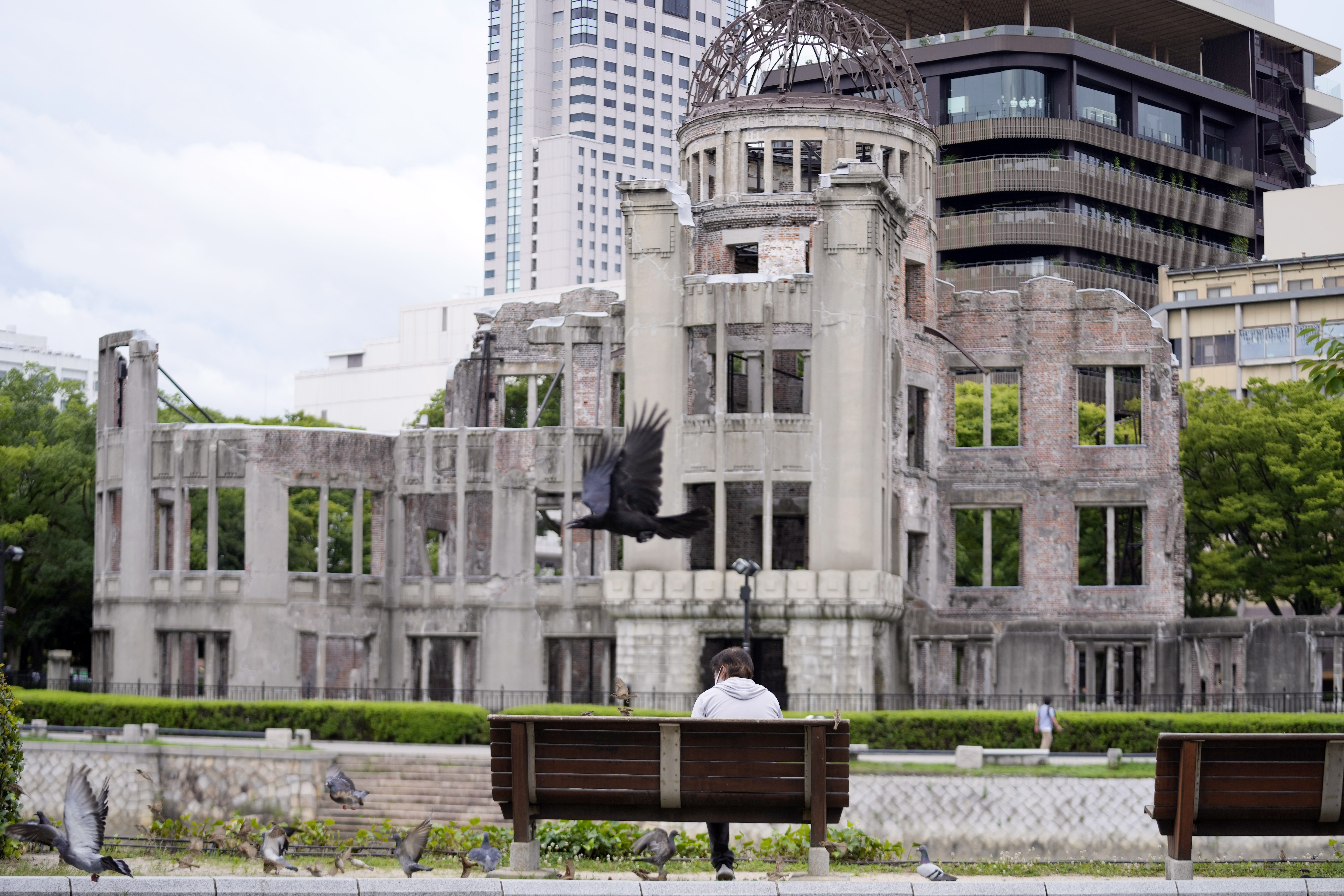 A man rests near the Atomic Bomb Dome Friday, July 16, 2021, in Hiroshima, western Japan.