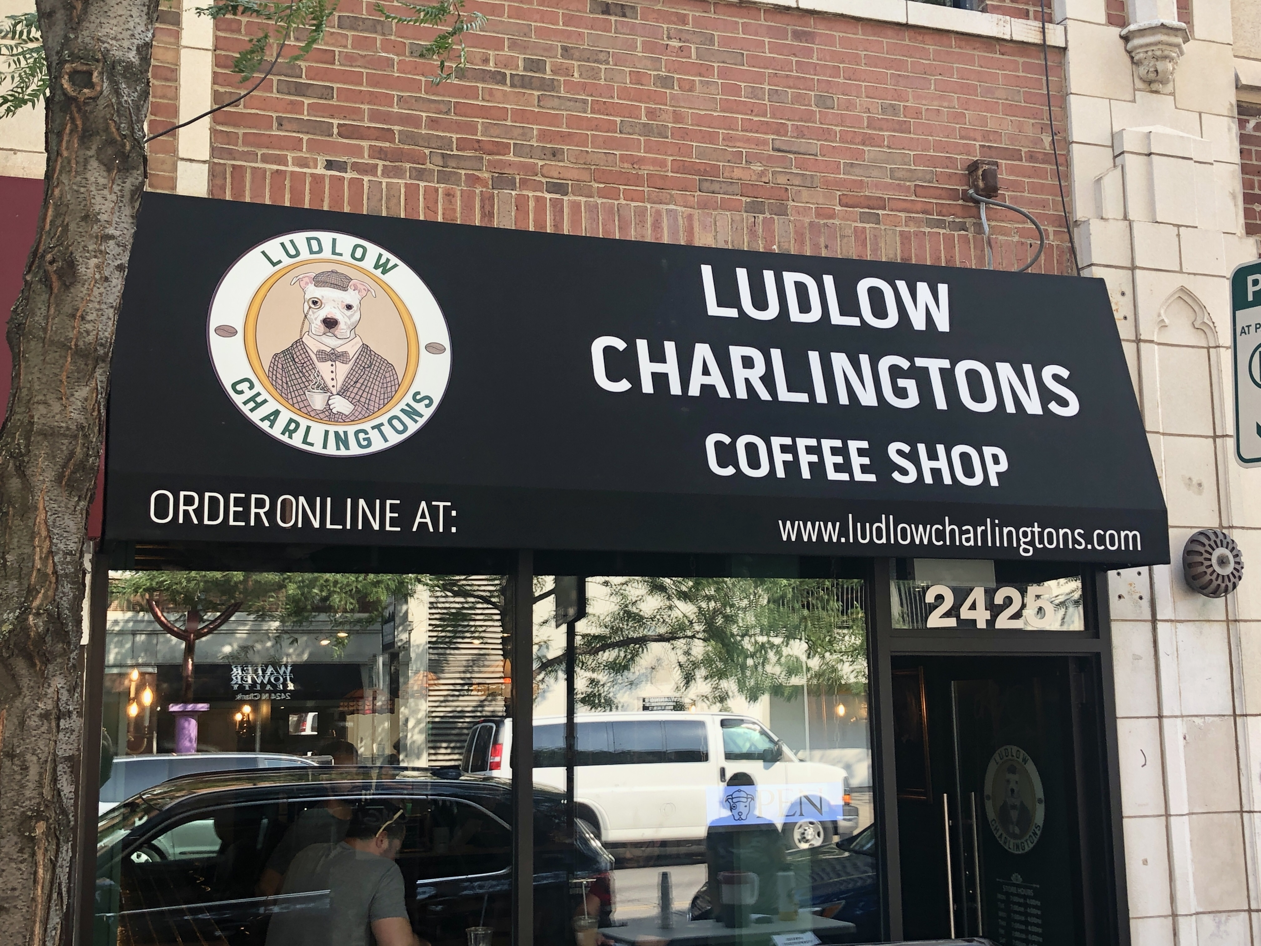 The exterior storefront of a coffeeshop.
