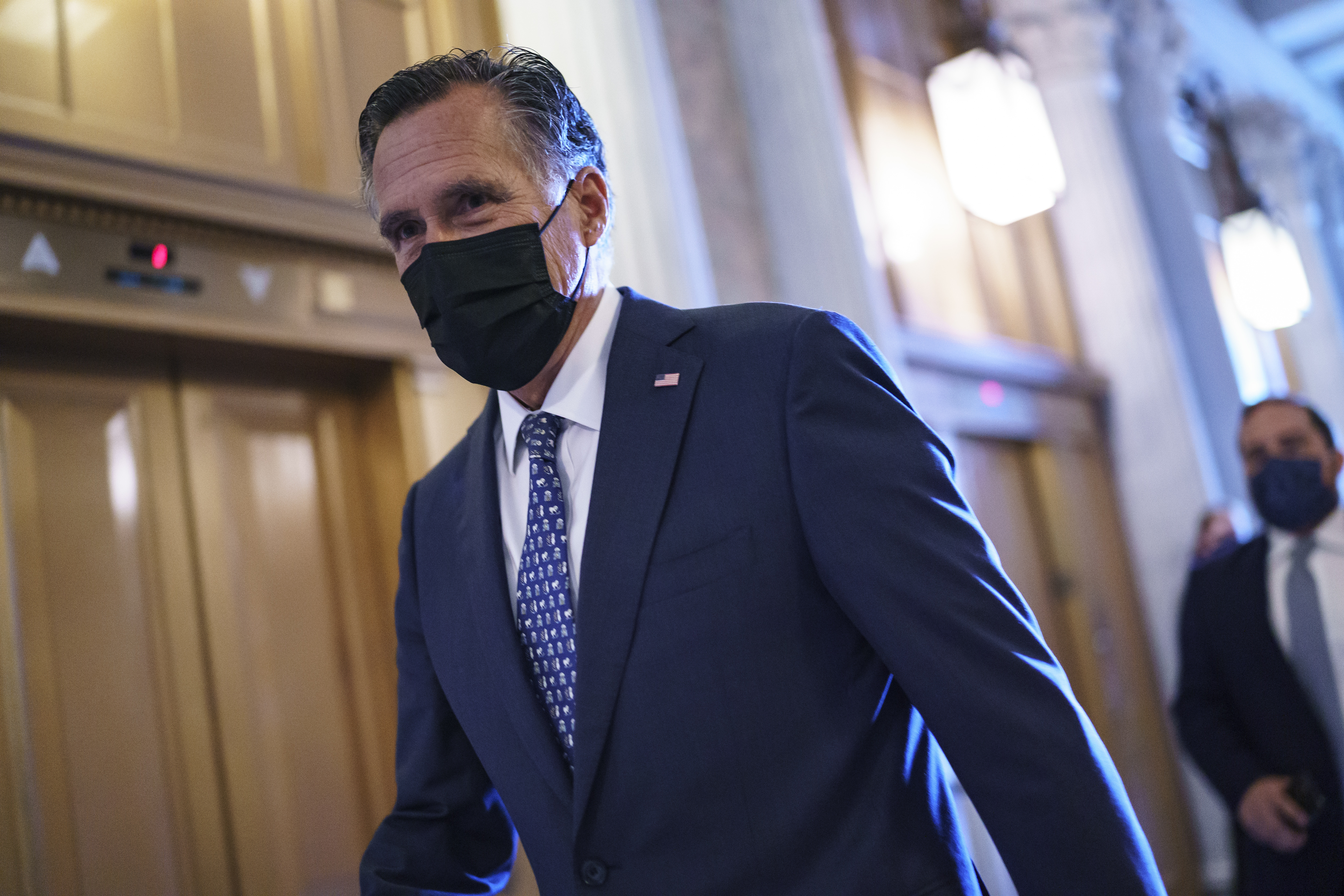 Utah Senator Mitt Romney arrives for a negotiating session over infrastructure.