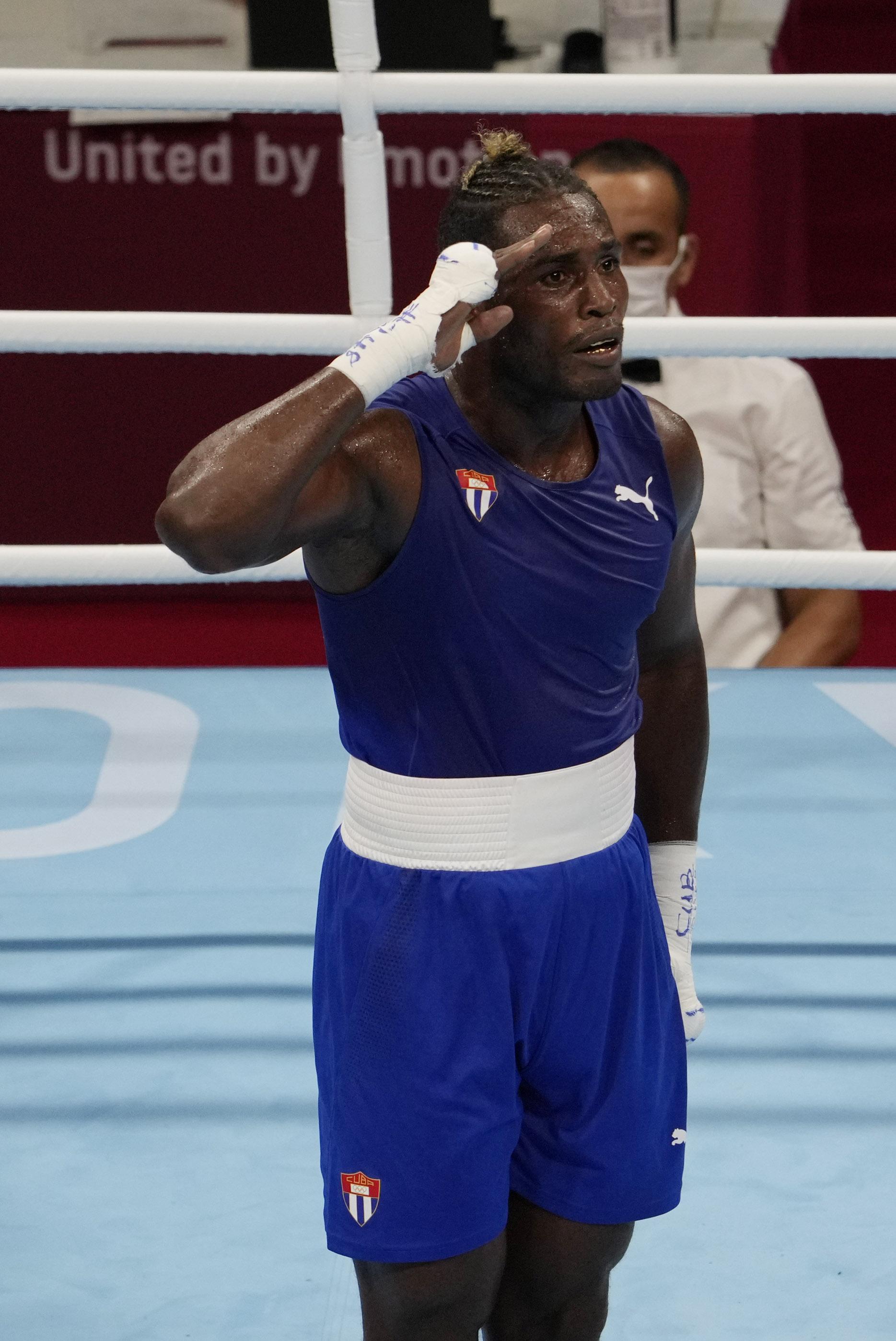Julio la Cruz (CUB) defeats Abner Teixeira (BRA) in a men's heavy 81-91kg semifinal during the Tokyo 2020 Olympic Summer Games at Kokugikan Arena.