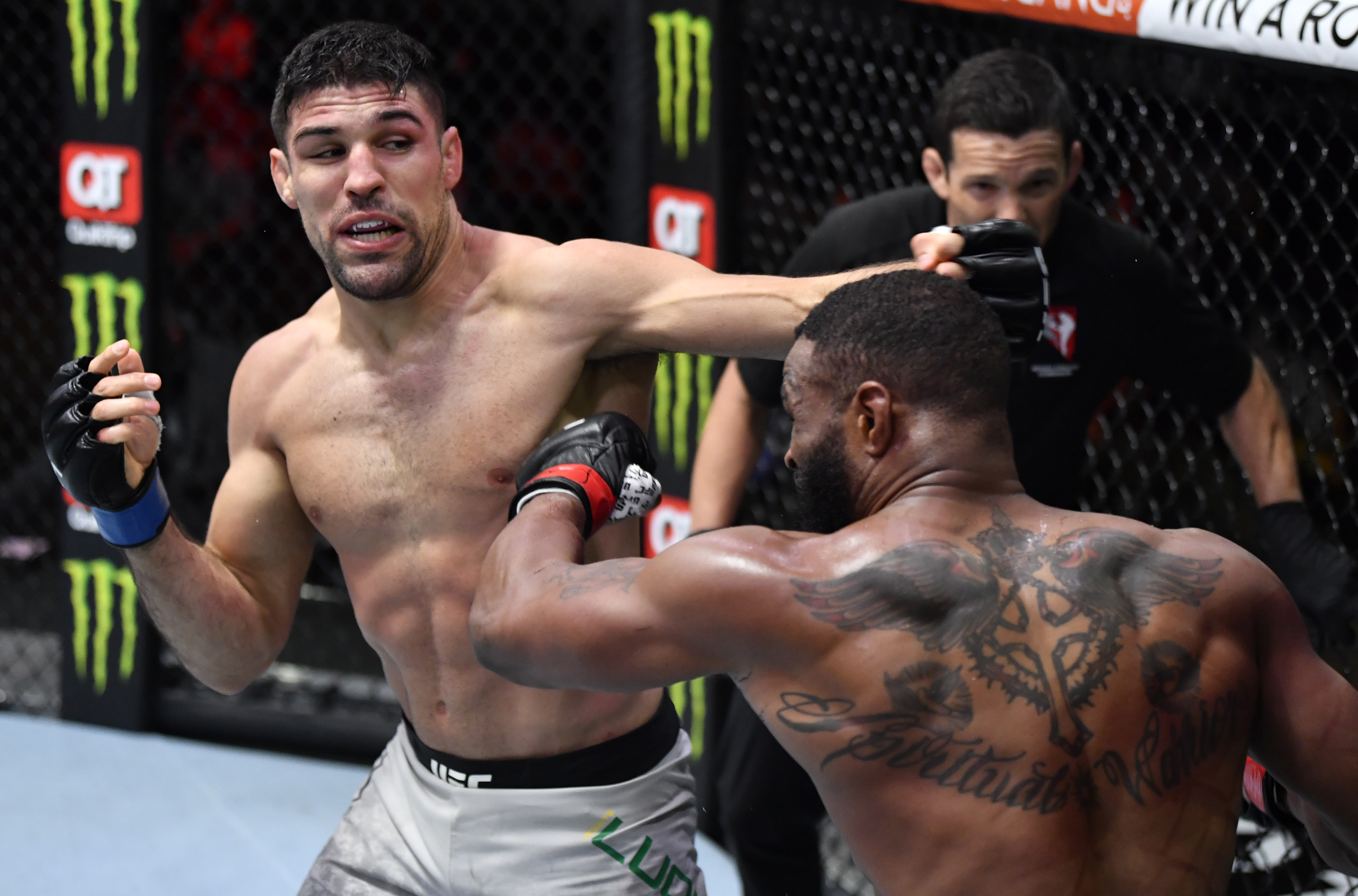 In this handout image provided by UFC, (L-R) Vicente Luque punches Tyron Woodley in their welterweight fight during the UFC 260 event at UFC APEX on March 27, 2021 in Las Vegas, Nevada.