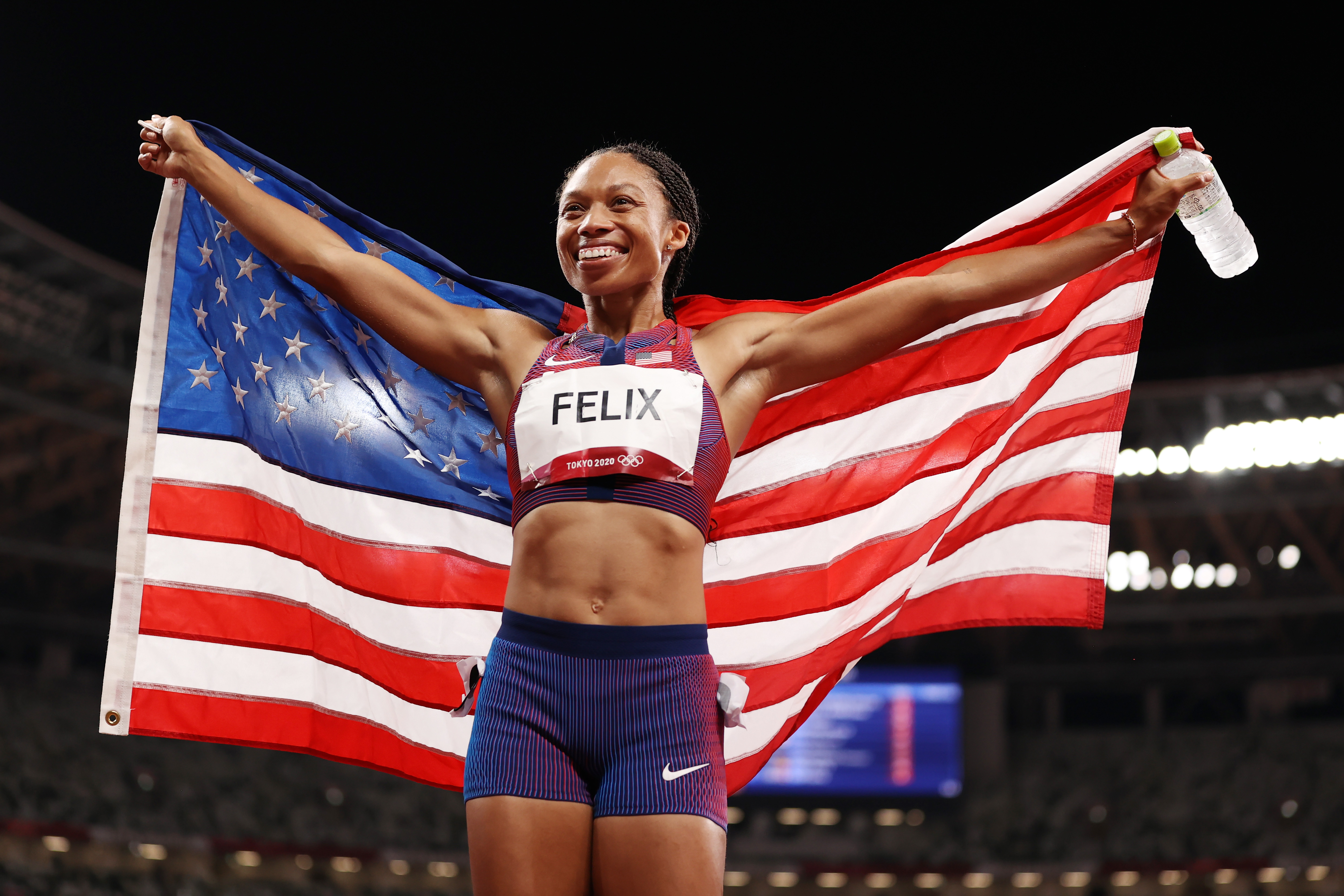Allyson Felix of Team USA reacts after winning the bronze medal in the Women's 400m Final on day fourteen of the Tokyo 2020 Olympic Games at Olympic Stadium on August 06, 2021 in Tokyo, Japan.