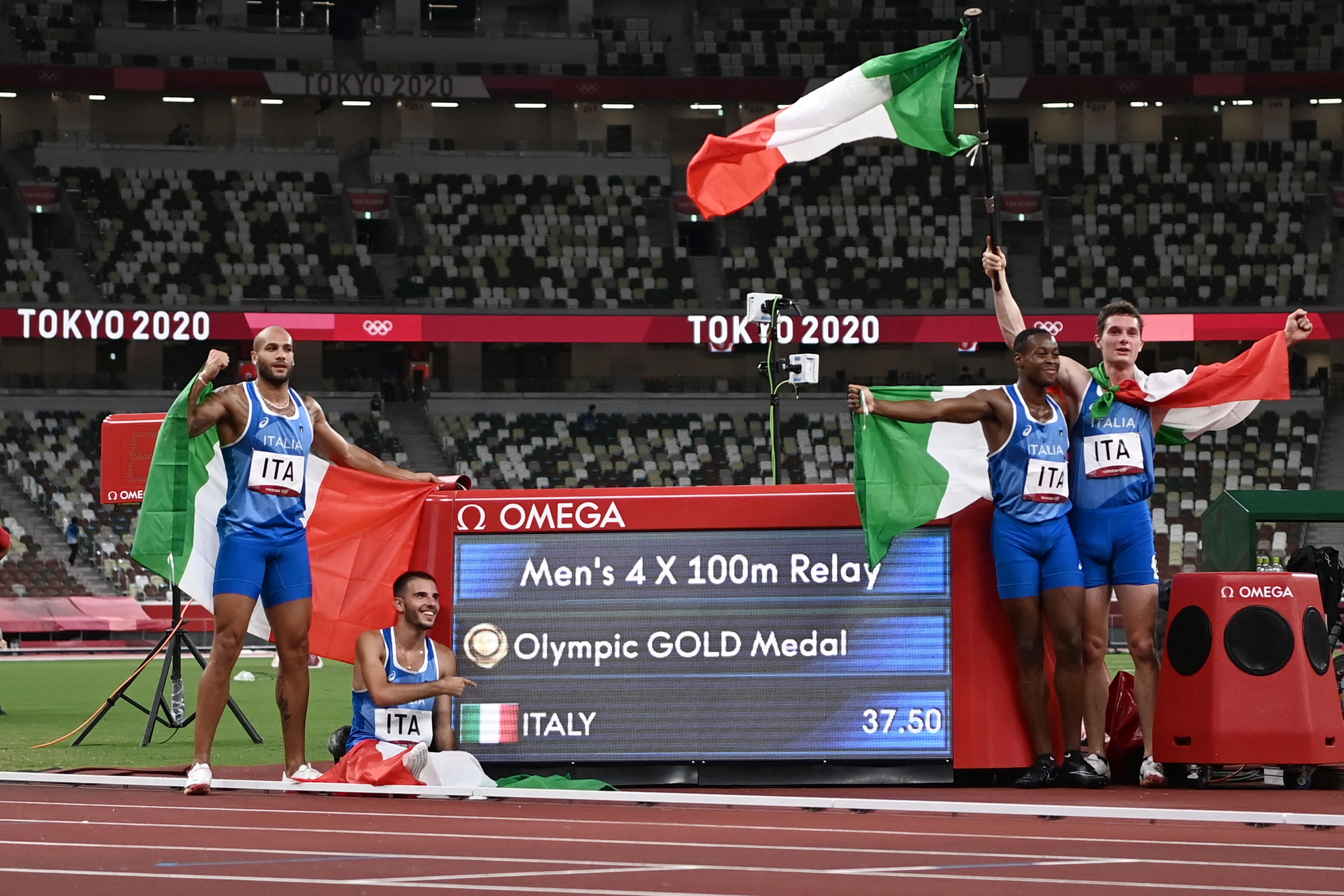Team Italy celebrate after the men's 4x100m relay final during the Tokyo 2020 Olympic Games at the Olympic Stadium in Tokyo on August 6, 2021.