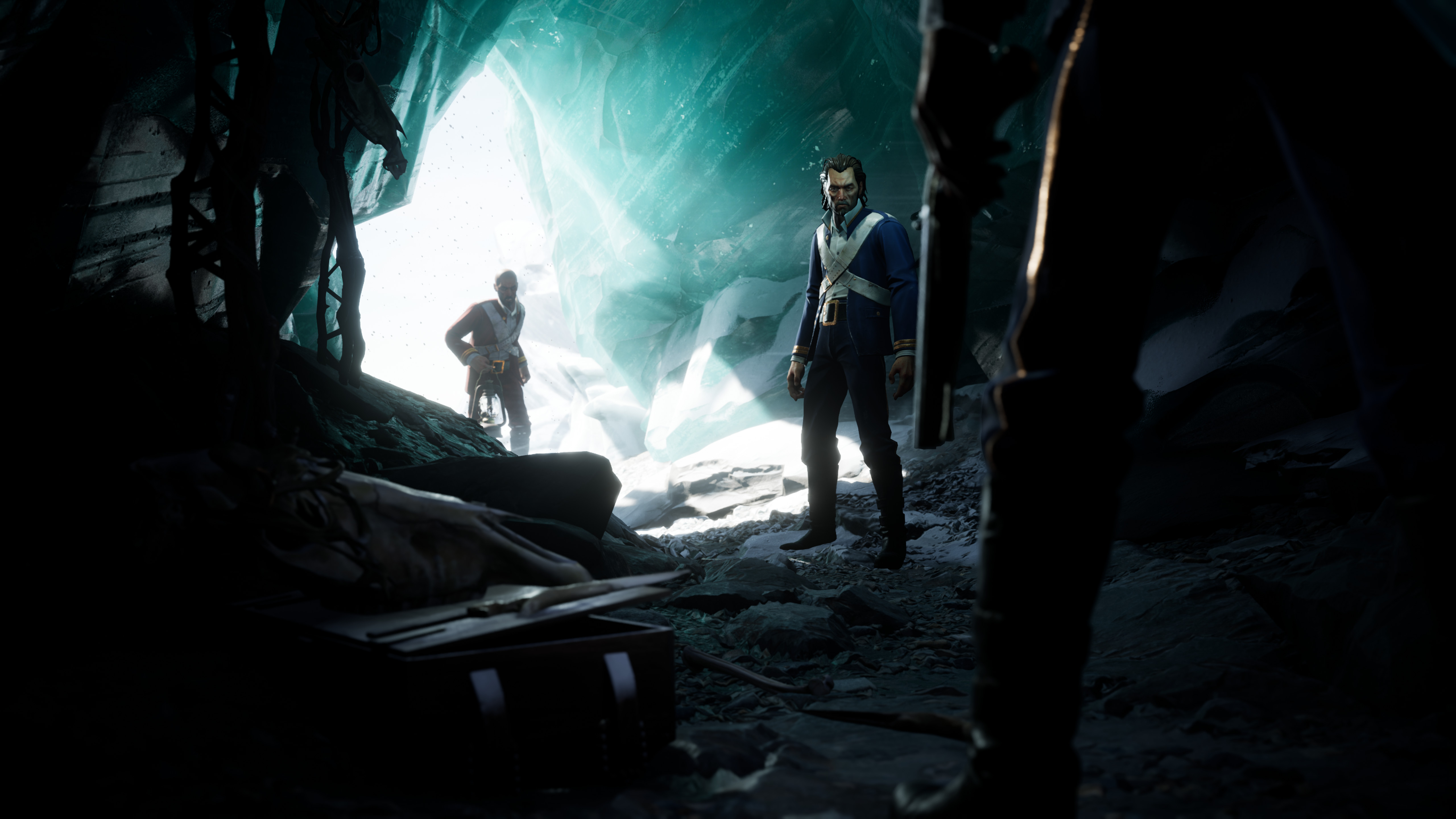 Dread Hunger - three people stand in an ice cave, one of whom is armed with a simple club