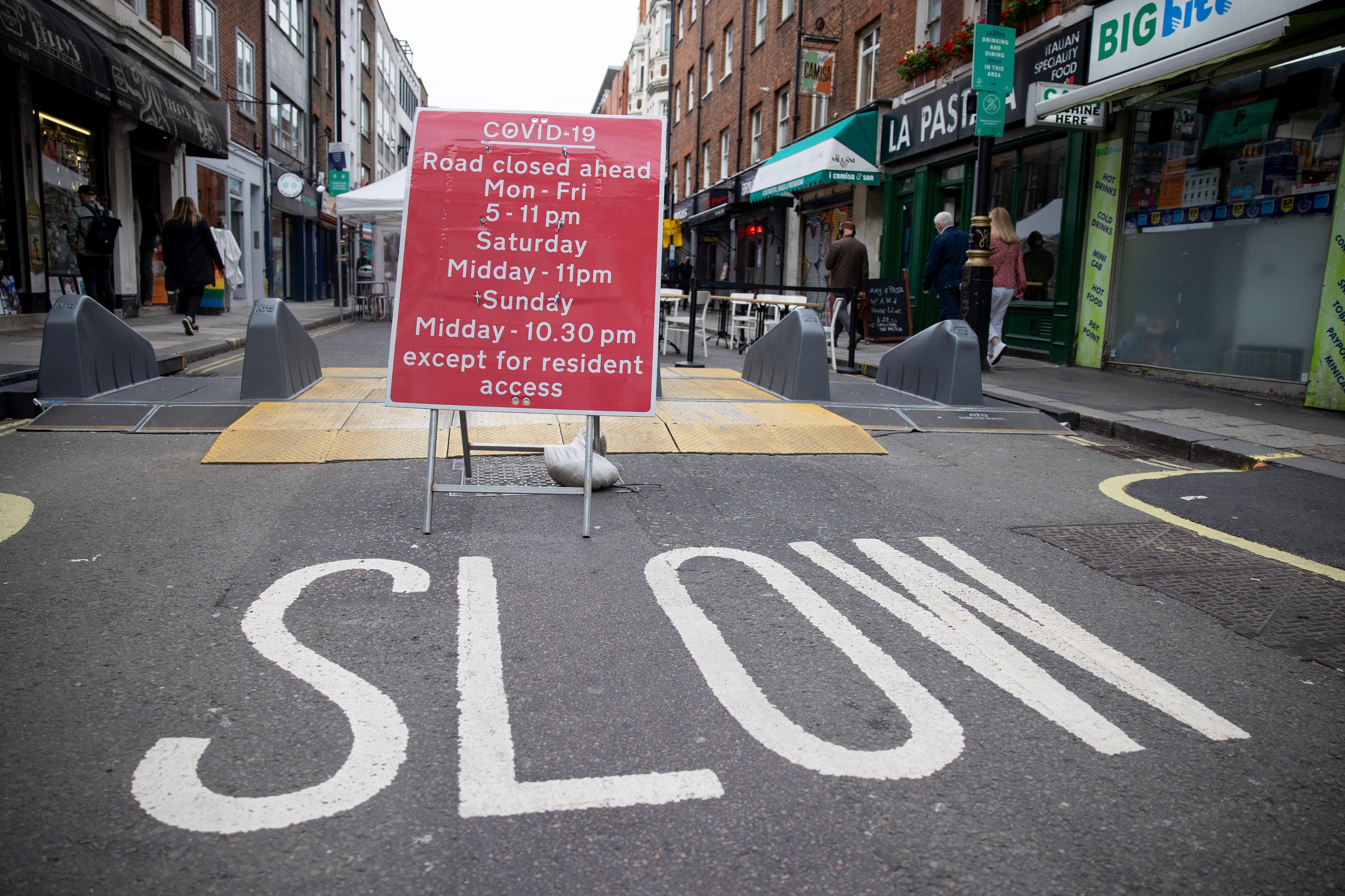 Road closure sign seen displayed in Soho. Road closure sign...
