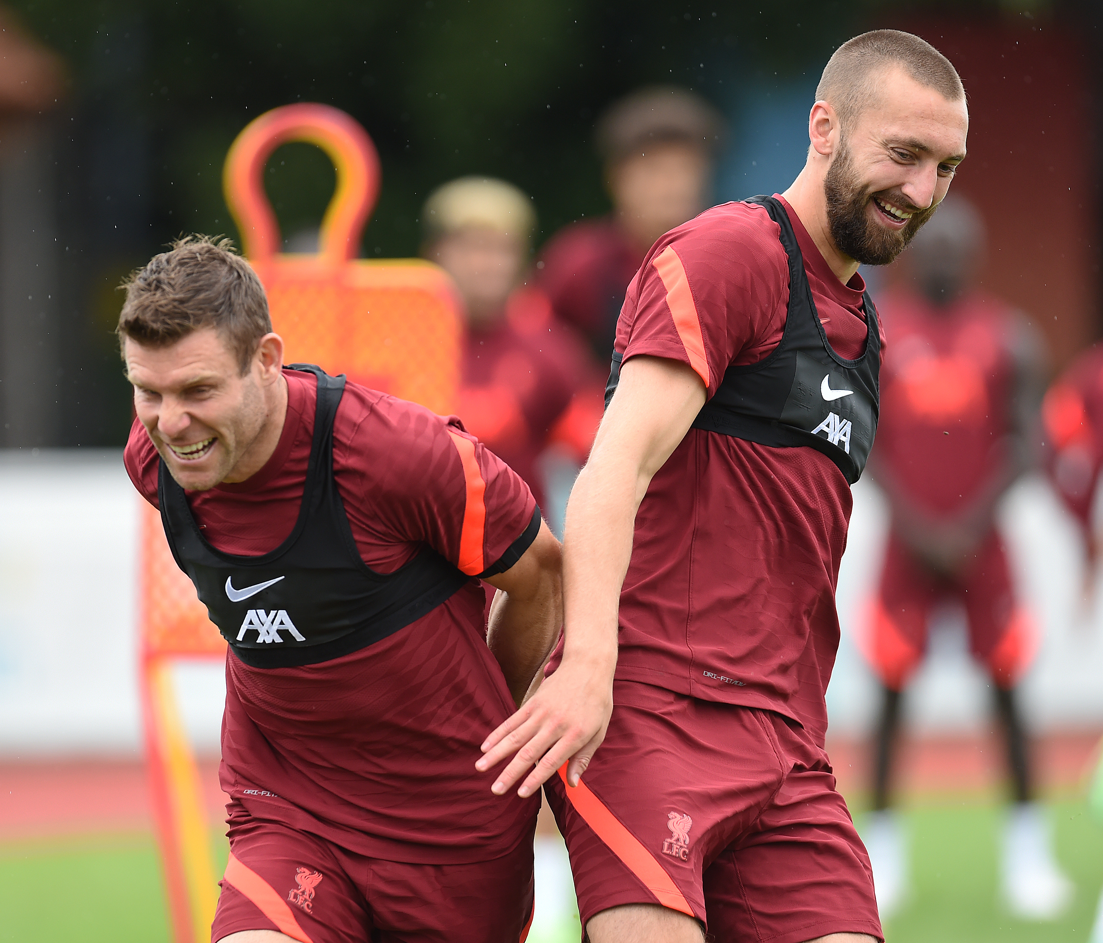 James Milner of Liverpool with Nathaniel Phillips of Liverpool during a training session on August 01, 2021 in France.