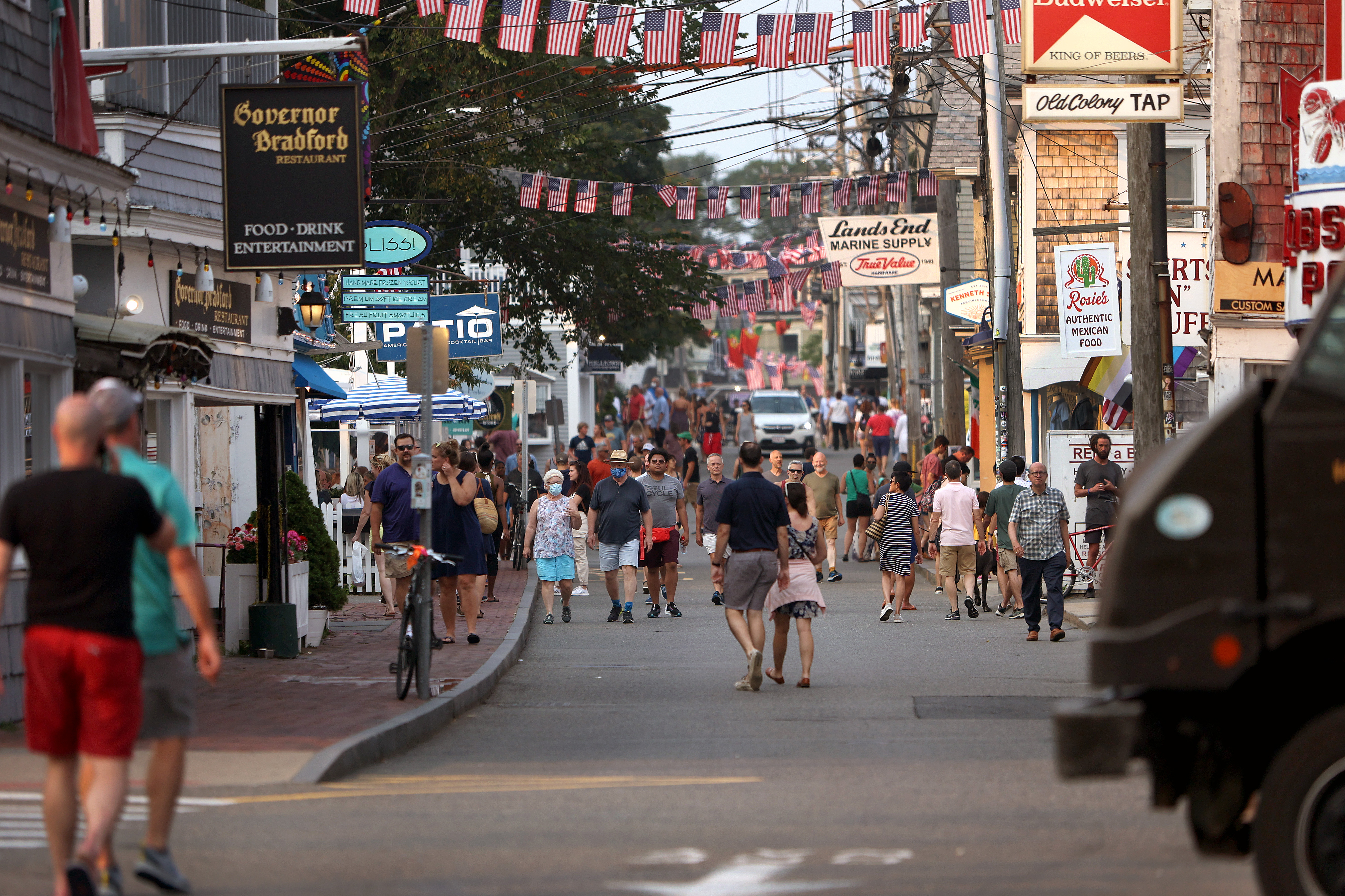 Foot traffic along Commercial Street in Provincetown, MA, on July 20, 2021. Provincetown officials have issued a new mask-wearing advisory for indoors regardless of vaccination status on the latest news data showing that Provincetown COVID cases are increasing.