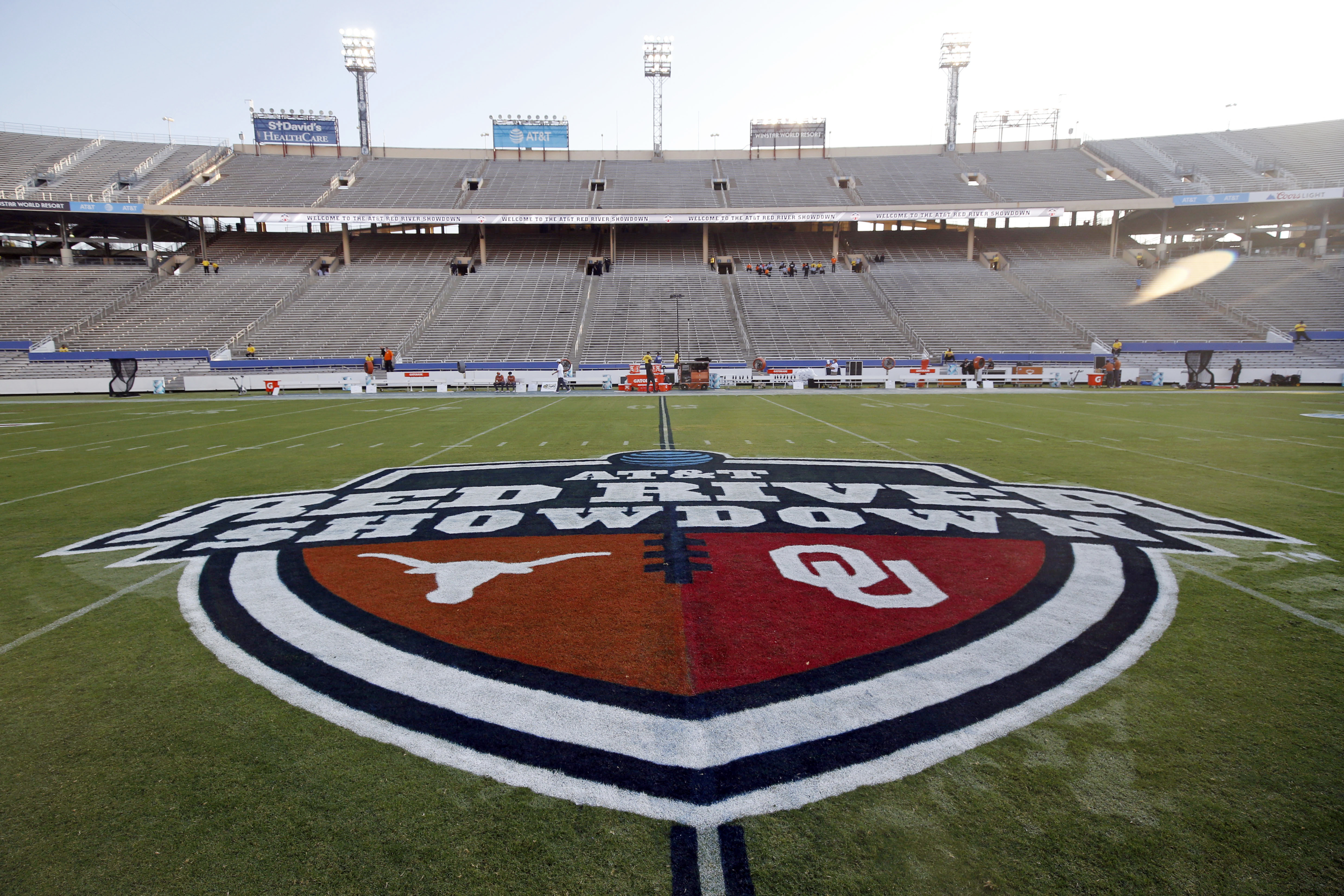 Texas and Oklahoma logos are seen on the Cotton Bowl field in Dallas.
