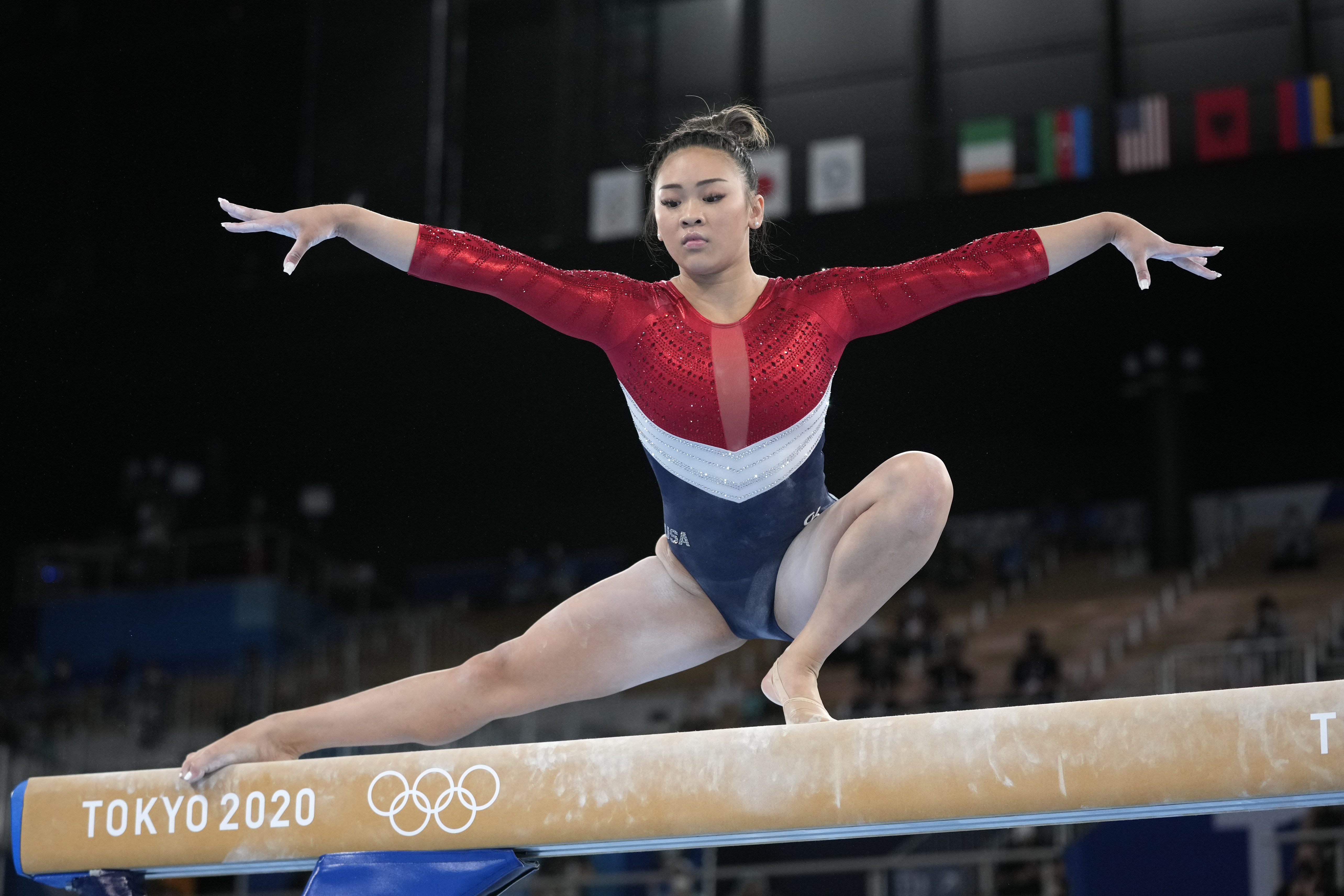 Sunisa Lee, of the United States, performs on the balance beam during the artistic gymnastics women's final at the 2020 Summer Olympics,