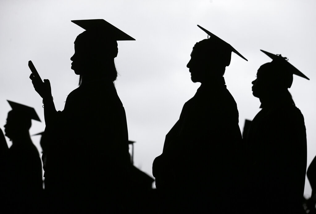 Graduates line up before the start of the Bergen Community College in East Rutherford, N.J.