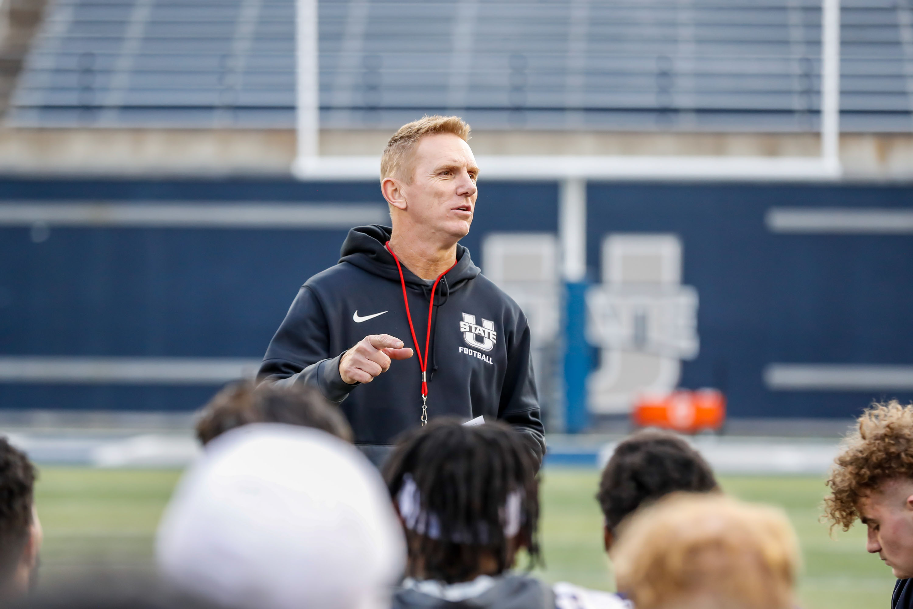 Utah State football coach Blake Anderson addresses his team at the end of a spring practice in April 2021.