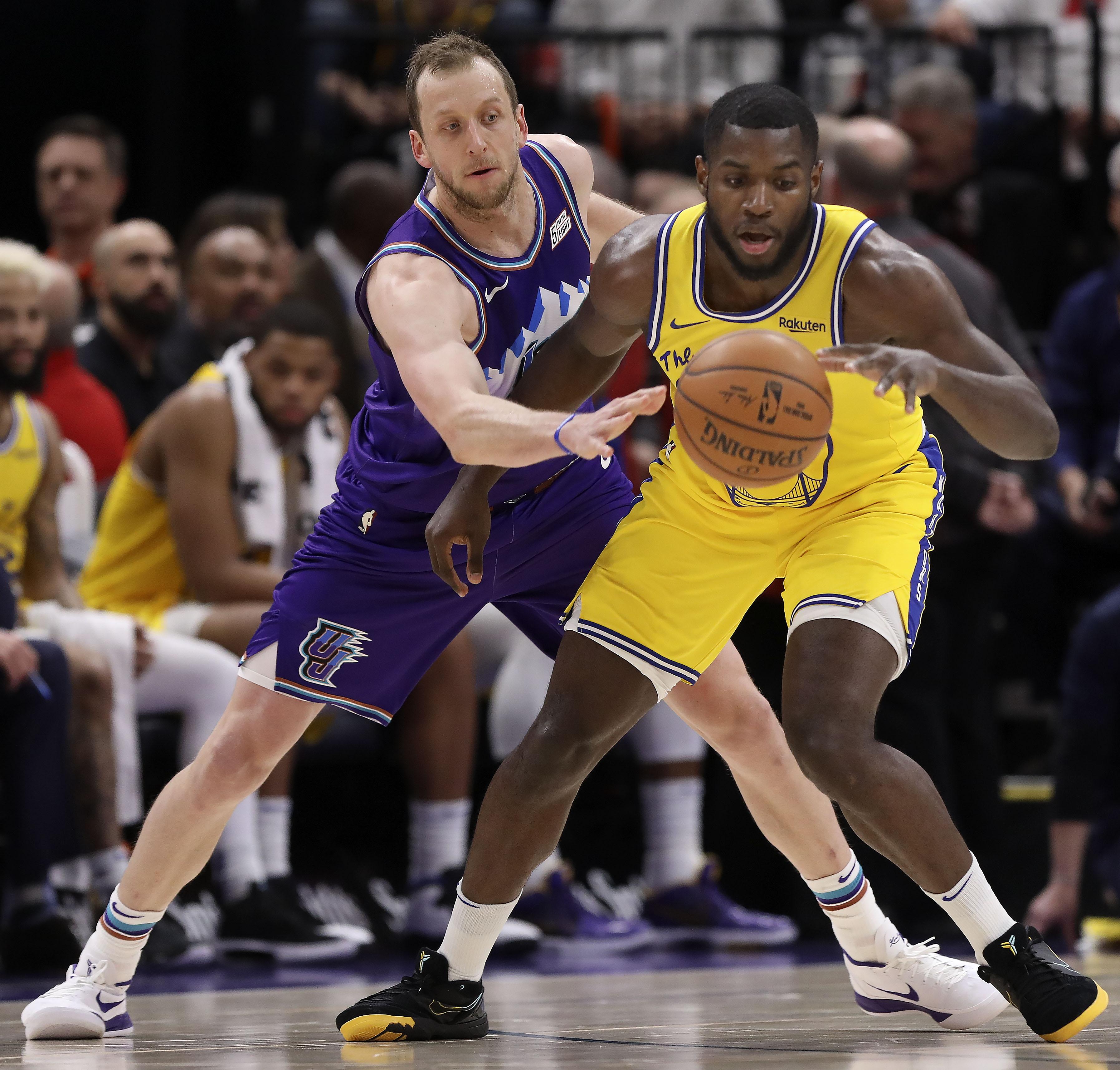 Utah Jazz forward Joe Ingles guards Golden State Warriors Eric Paschall at Vivint Arena in Salt Lake City on Friday, Nov. 22, 2019.