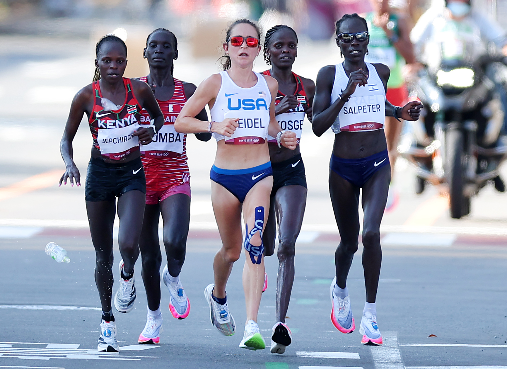 Peres Jepchirchir of Team Kenya, Eunice Chebichii Chumba of Team Bahrain, Molly Seidel of Team United States Brigid Kosgei of Team Kenya and Lonah Chemtai Salpeter of Team Israel compete in the Women's Marathon Final on day fifteen of the Tokyo 2020 Olympic Games at Kasumigaseki Country Club on August 07, 2021 in Kawagoe, Japan.