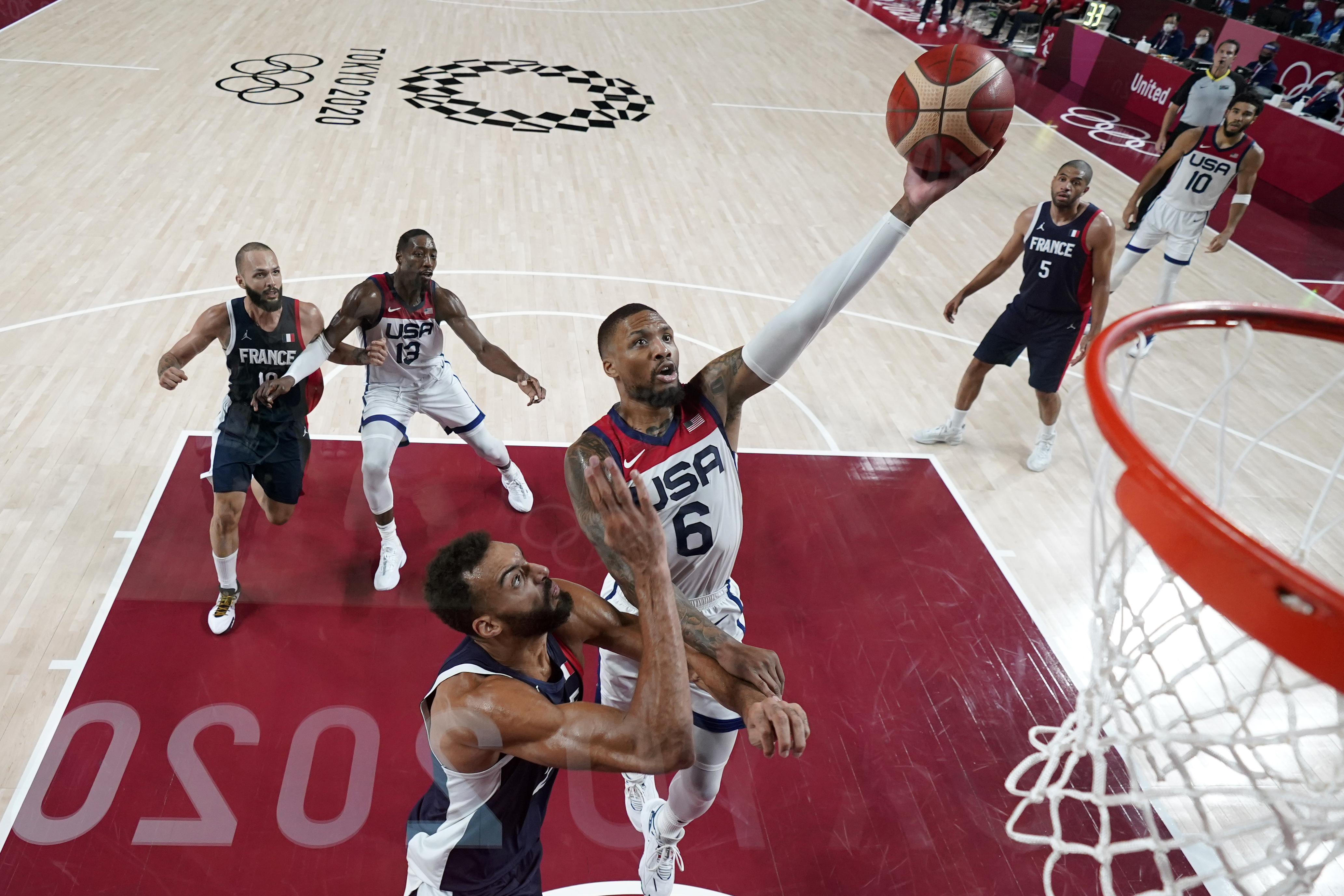 United States' Damian Lillard drives to the basket over France's Rudy Gobert