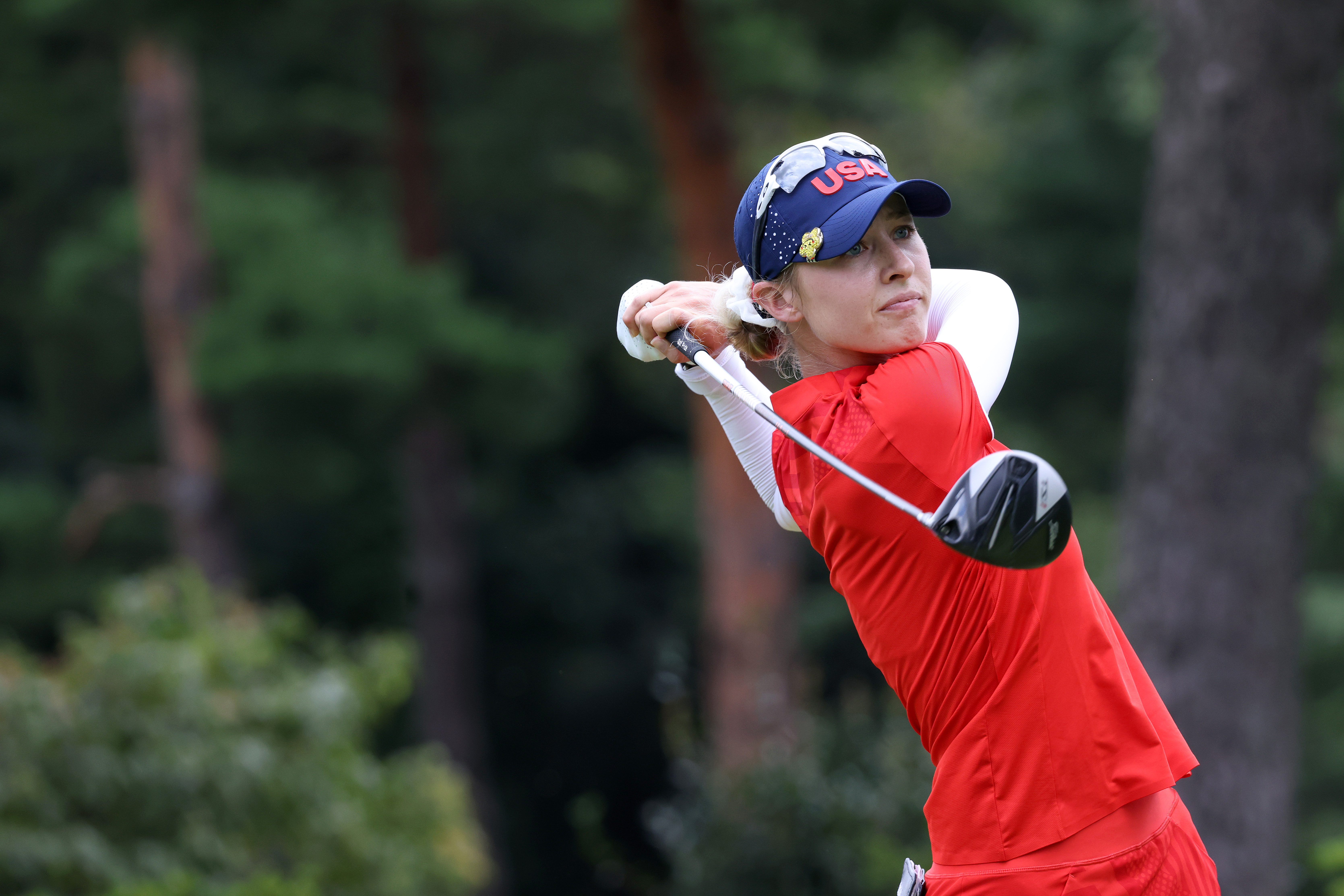 Nelly Korda of Team United States plays her shot from the 12th tee during the final round of the Women's Individual Stroke Play on day fifteen of the Tokyo 2020 Olympic Games at Kasumigaseki Country Club on August 07, 2021 in Kawagoe, Japan.