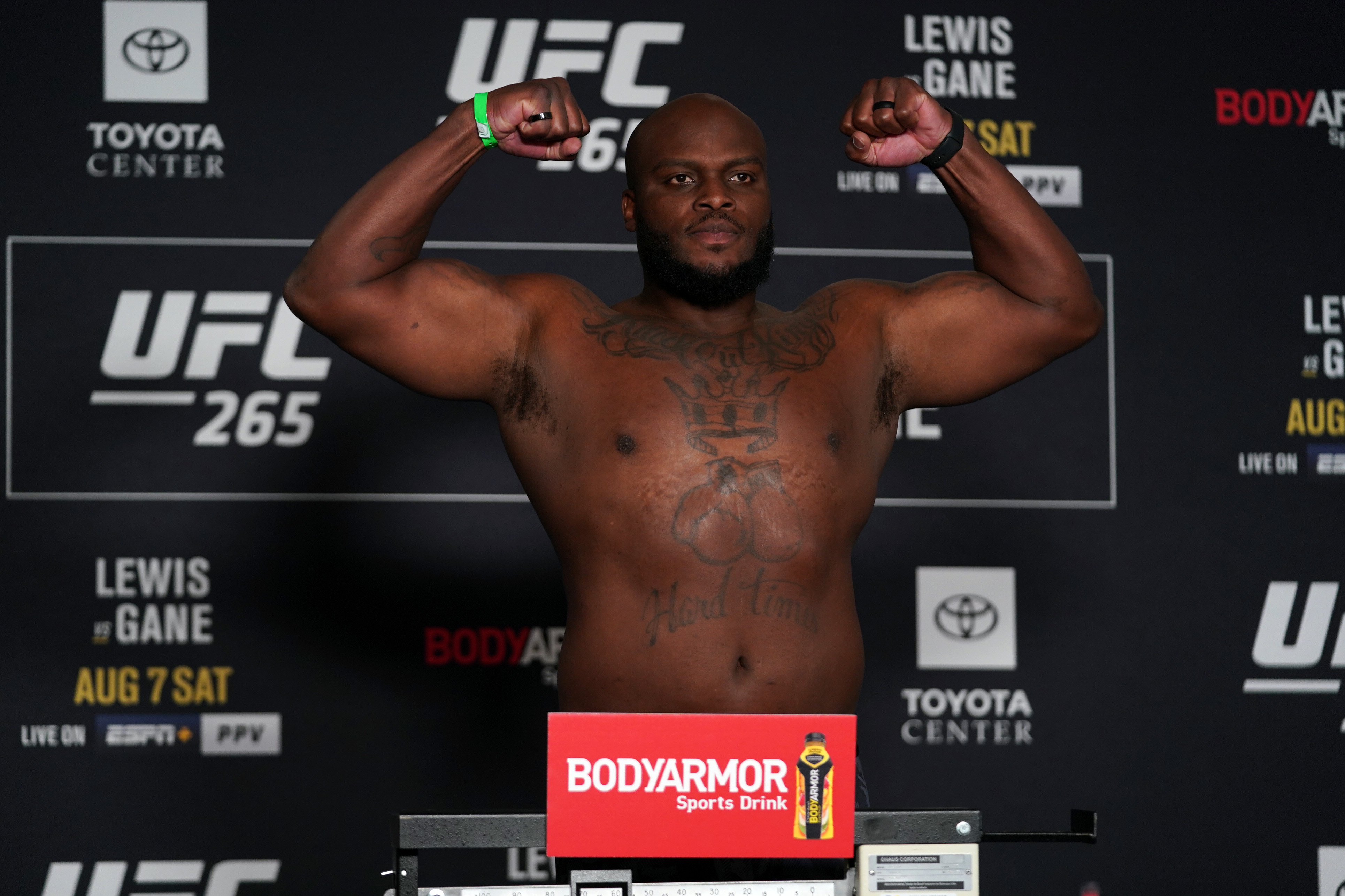 Derrick Lewis poses on the scale during the UFC 265 official weigh-in at Hyatt Regency Houston on August 06, 2021 in Houston, Texas.
