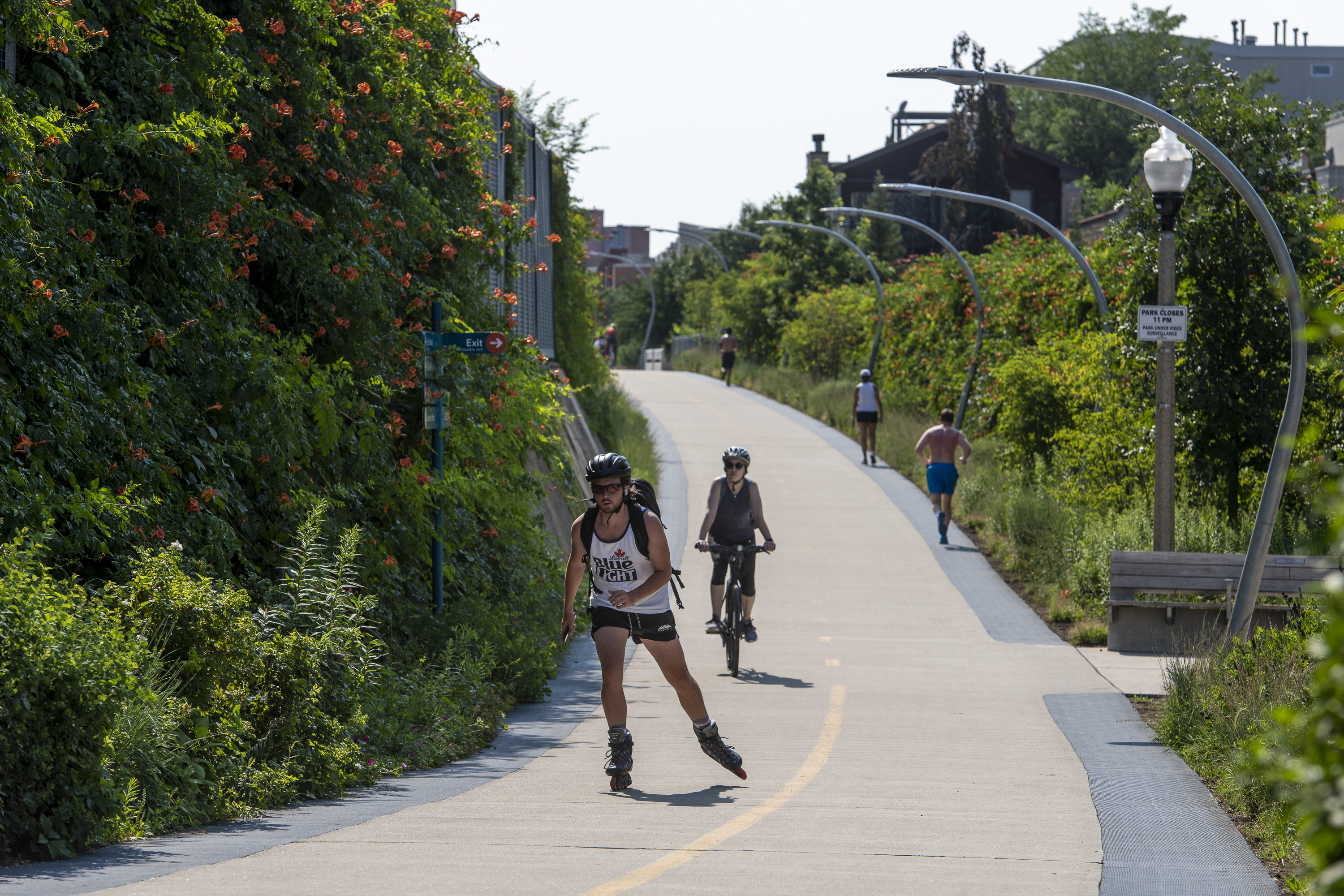 People jog, cycle and rollerblade along The 606 trail near North Damen Avenue in the Bucktown neighborhood.