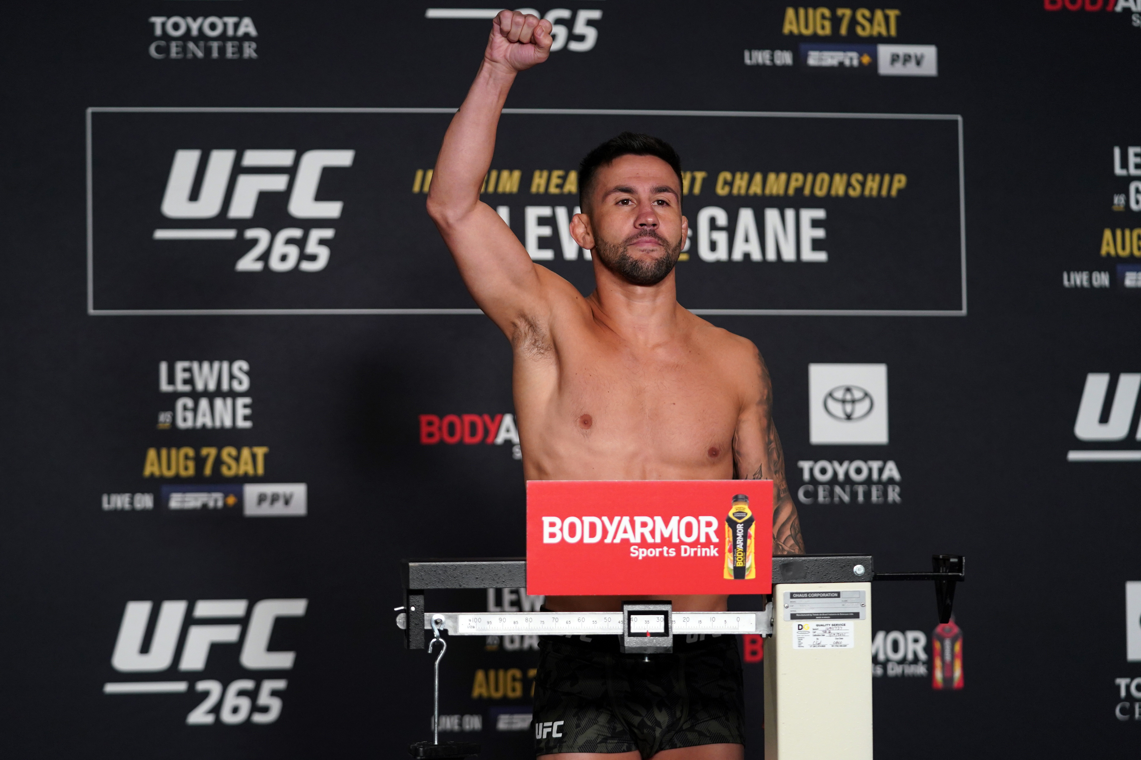Pedro Munhoz poses on the scale during the UFC 265 official weigh-in at Hyatt Regency Houston on August 06, 2021 in Houston, Texas.
