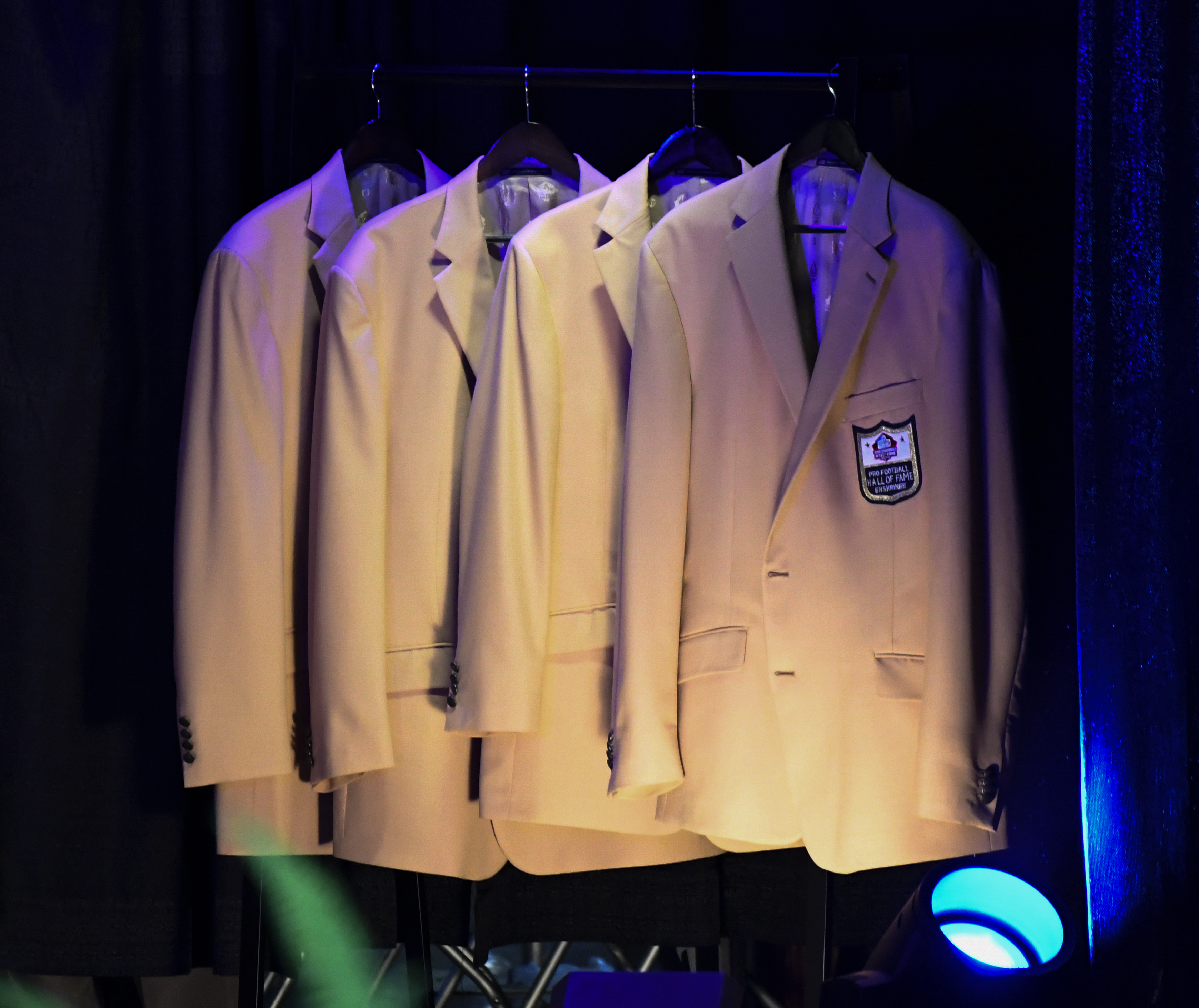 Pro Football Hall of Fame enshrines' Gold Jackets hang in the background awaiting ownership on August 4, 2017 in Canton, Ohio.