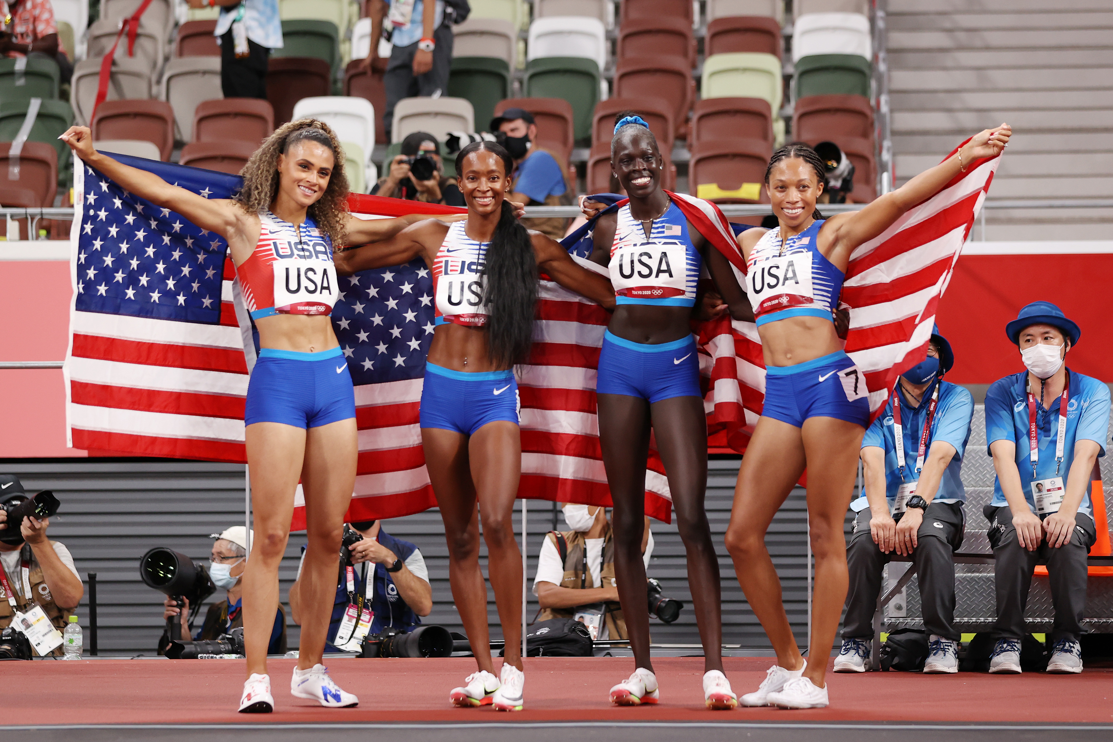 Sydney McLaughlin, Allyson Felix, Dalilah Muhammad and Athing Mu of Team United States celebrate winning the gold medal in the Women' s 4 x 400m Relay Final on day fifteen of the Tokyo 2020 Olympic Games at Olympic Stadium on August 07, 2021 in Tokyo, Japan.