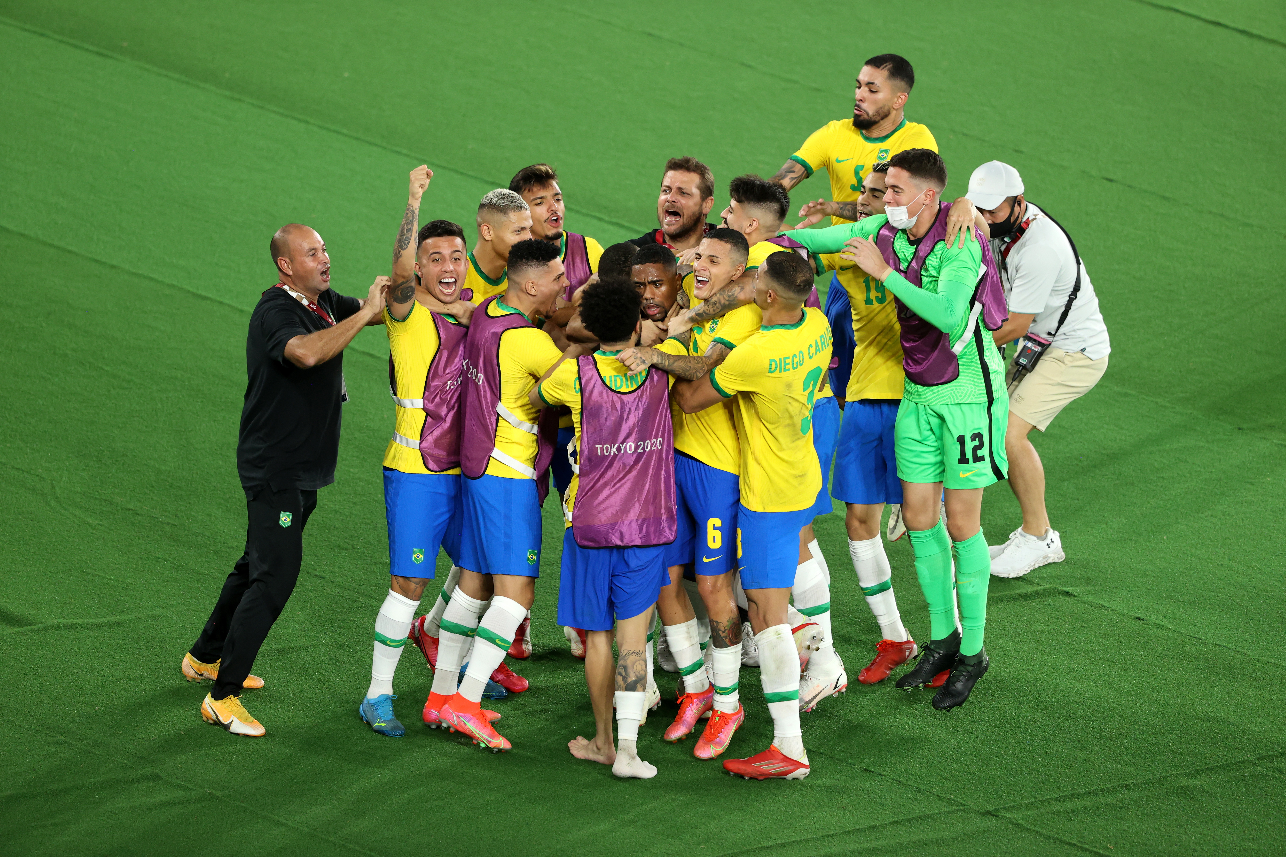 Malcom #17 of Team Brazil celebrates with team mates after scoring their side's second goal during the Men's Gold Medal Match between Brazil and Spain on day fifteen of the Tokyo 2020 Olympic Games at International Stadium Yokohama on August 07, 2021 in Yokohama, Kanagawa, Japan.