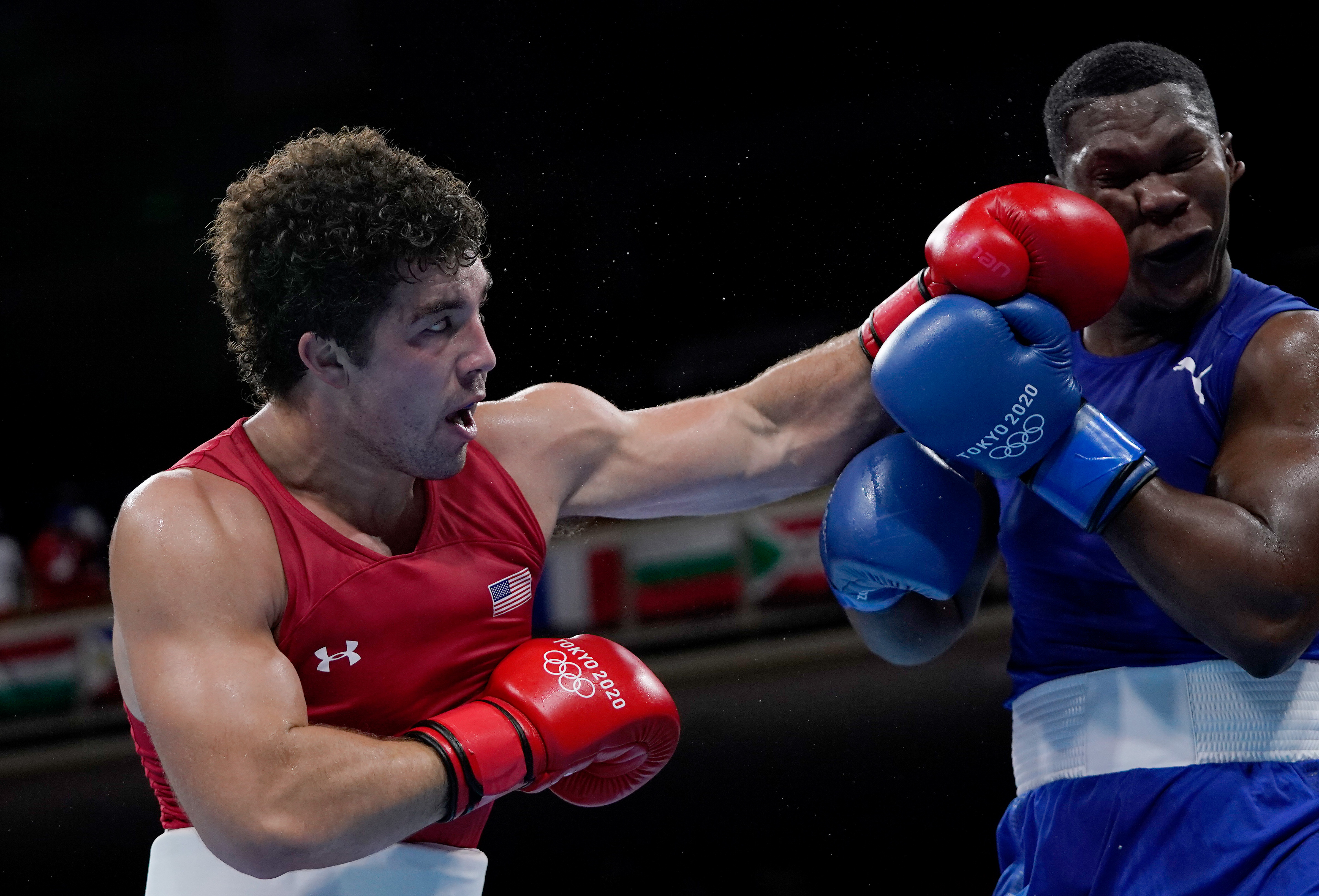 Richard Torrez Junior (red) of Team United States exchanges punches with Dainier Pero of Team Cuba during the Men's Super Heavy (+91kg) semi final on day nine of the Tokyo 2020 Olympic Games at Kokugikan Arena on August 01, 2021 in Tokyo, Japan.