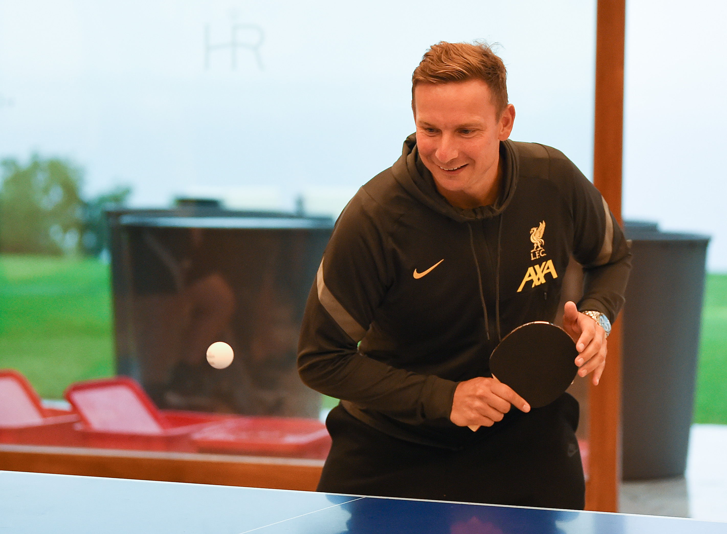 Liverpool Players Play a Table Tennis Tournament at Their Pre-Season Training Camp