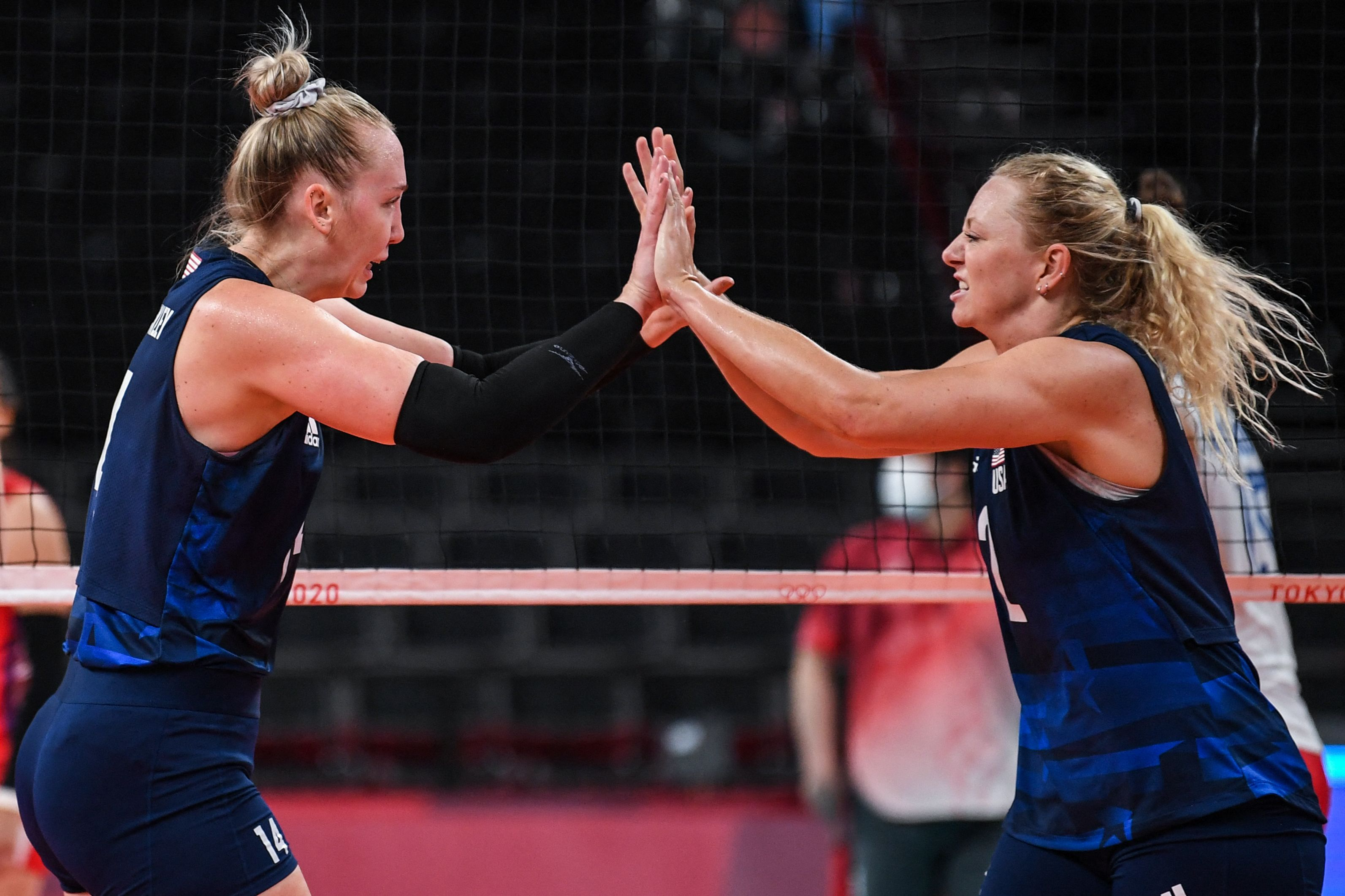 Michelle Bartsch-Hackley and Jordyn Poulter react after a point in the women's semi-final volleyball match between USA and Serbia during the Tokyo 2020 Olympic Games at Ariake Arena in Tokyo on August 6, 2021.