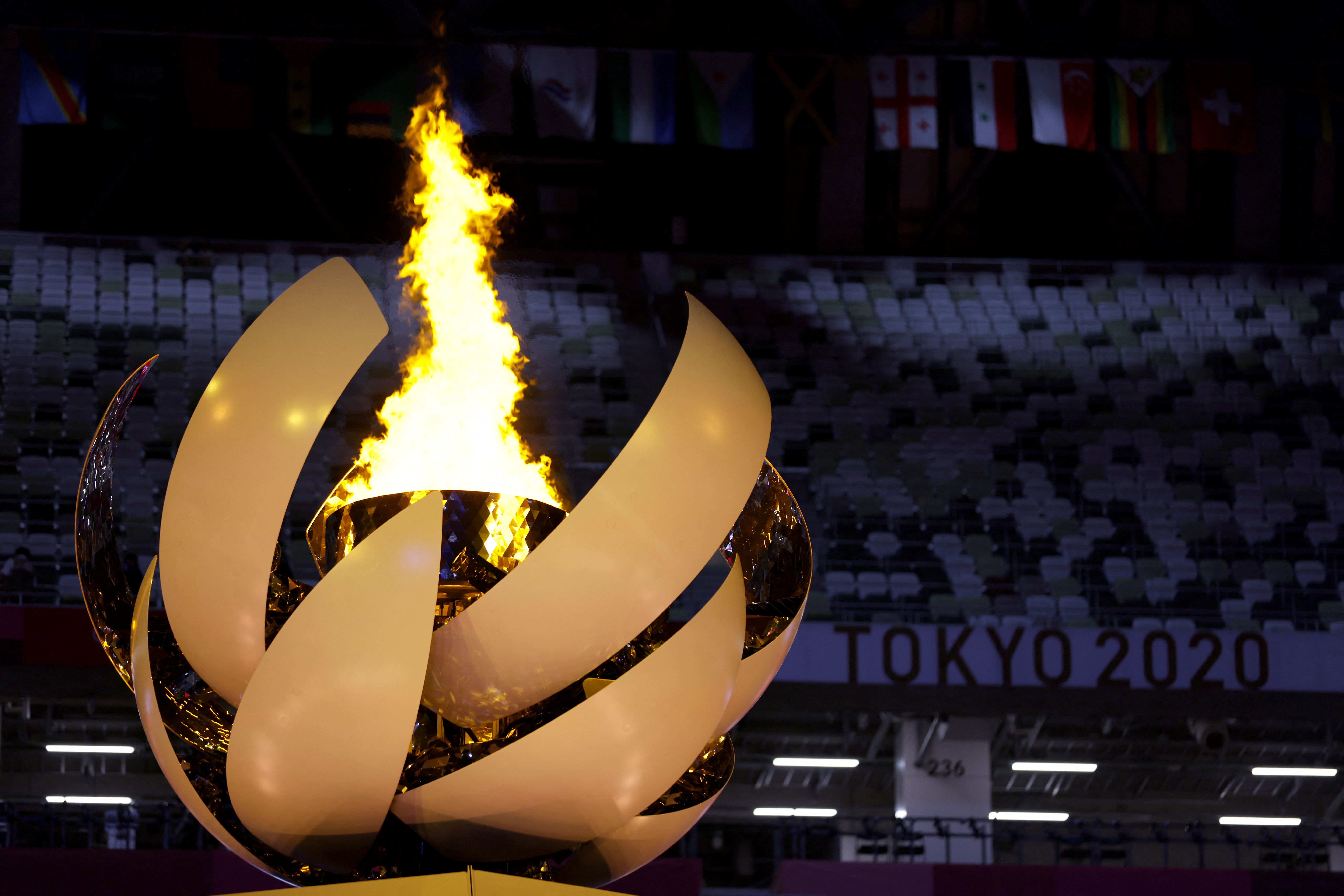 This picture shows the Olympic cauldron and flame during the opening ceremony of the Tokyo 2020 Olympic Games, at the Olympic Stadium, in Tokyo, on July 23, 2021.