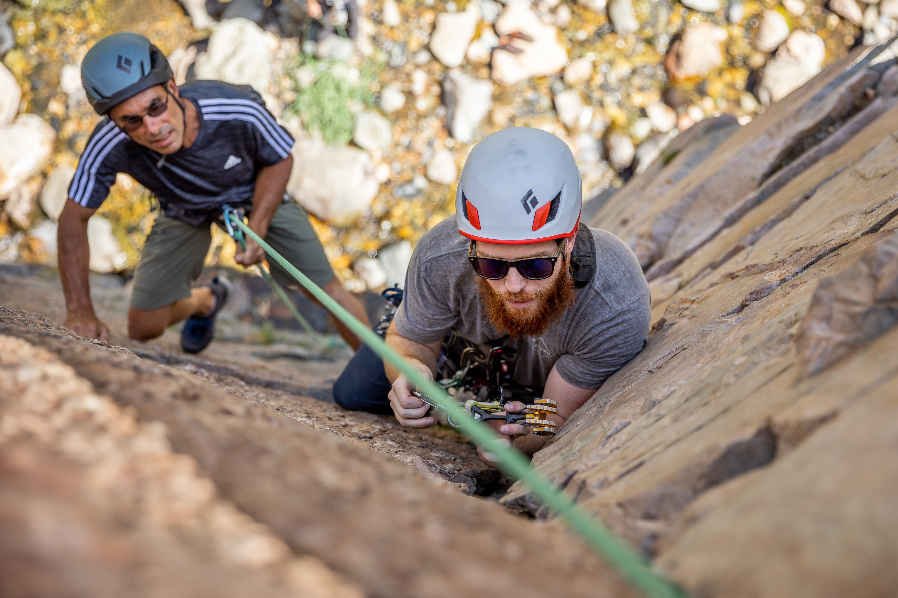 Quino Gonzalez, a guide and instructor for Utah Mountain Adventures, supervises while Daman Bareiss places protection during a trad climbing clinic in Big Cottonwood Canyon.