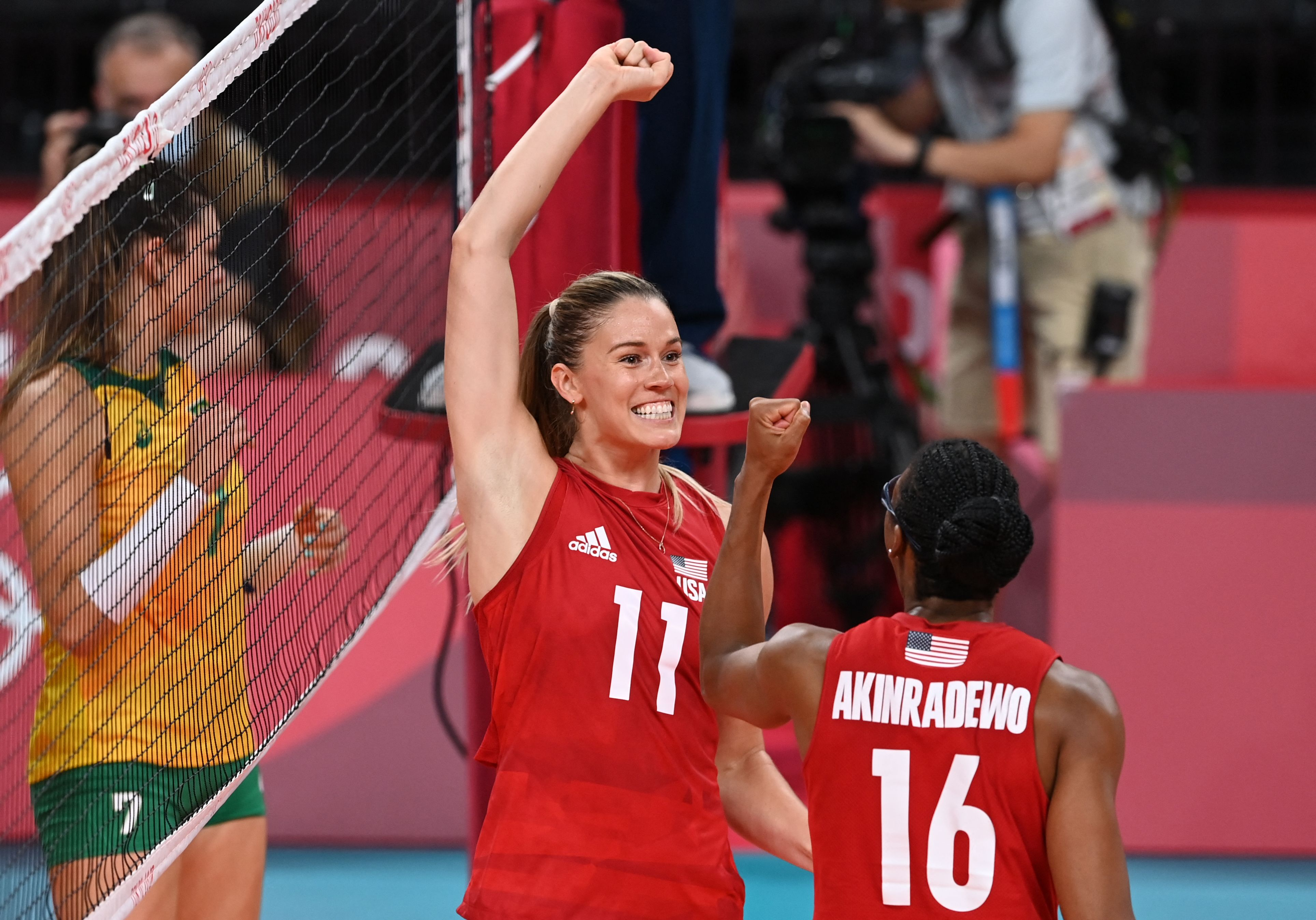 USA's Andrea Drews and USA's Foluke Akinradewo react after a point in the women's gold medal volleyball match between Brazil and USA during the Tokyo 2020 Olympic Games at Ariake Arena in Tokyo on August 8, 2021.
