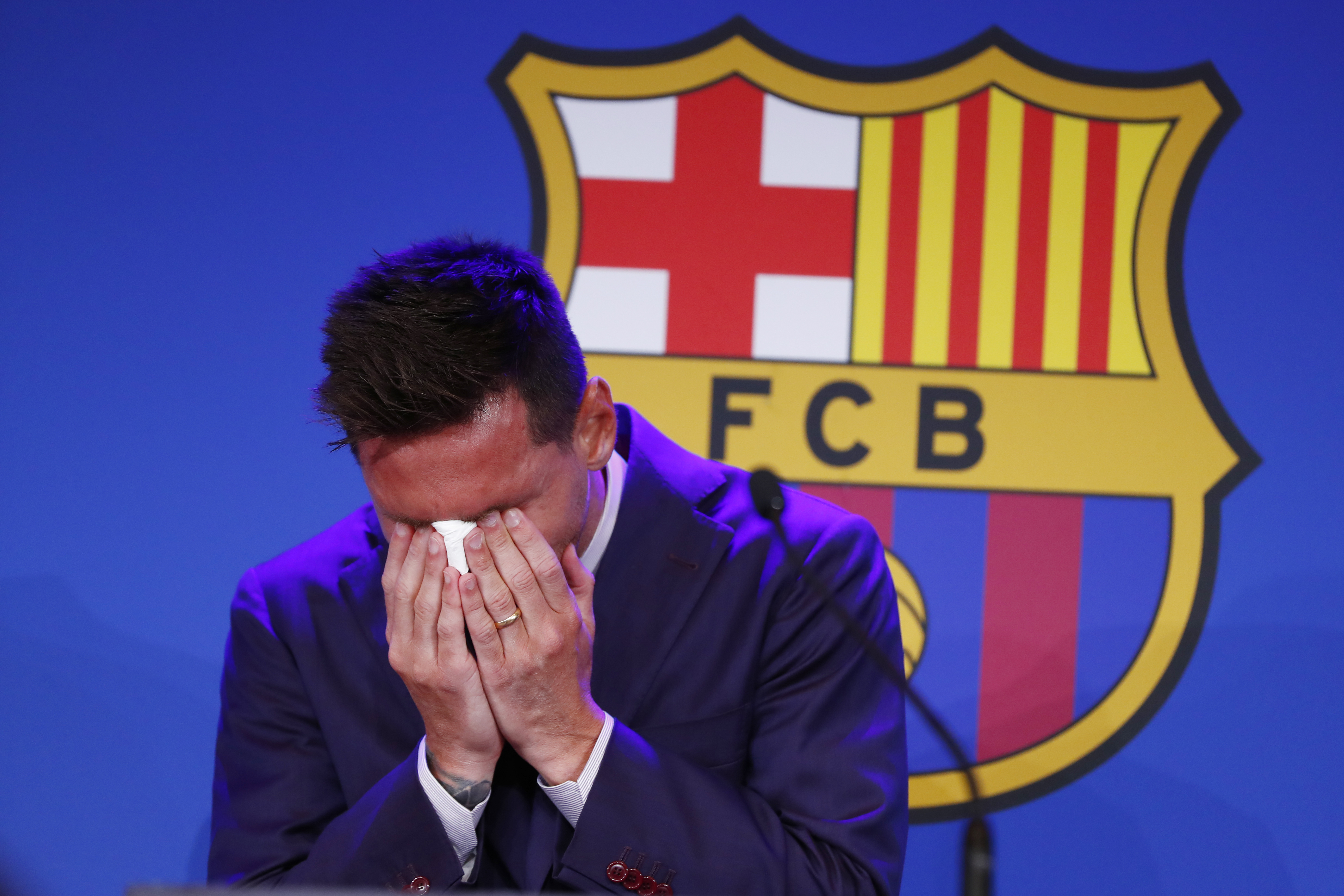 Lionel Messi cries at the start of a press conference at the Camp Nou stadium in Barcelona.