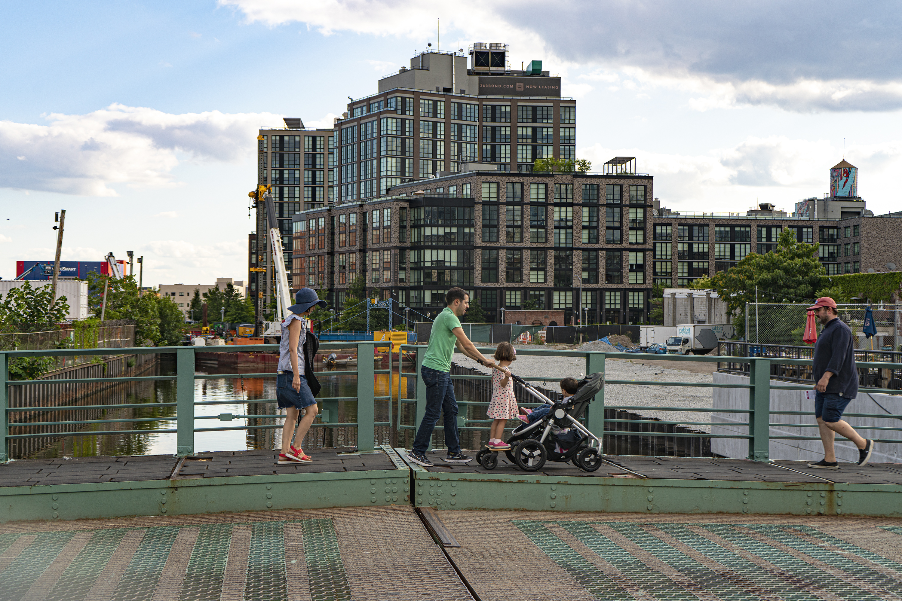 A family crosses the Union St. bridge over the Gowanus canal in the area proposed for rezoning.