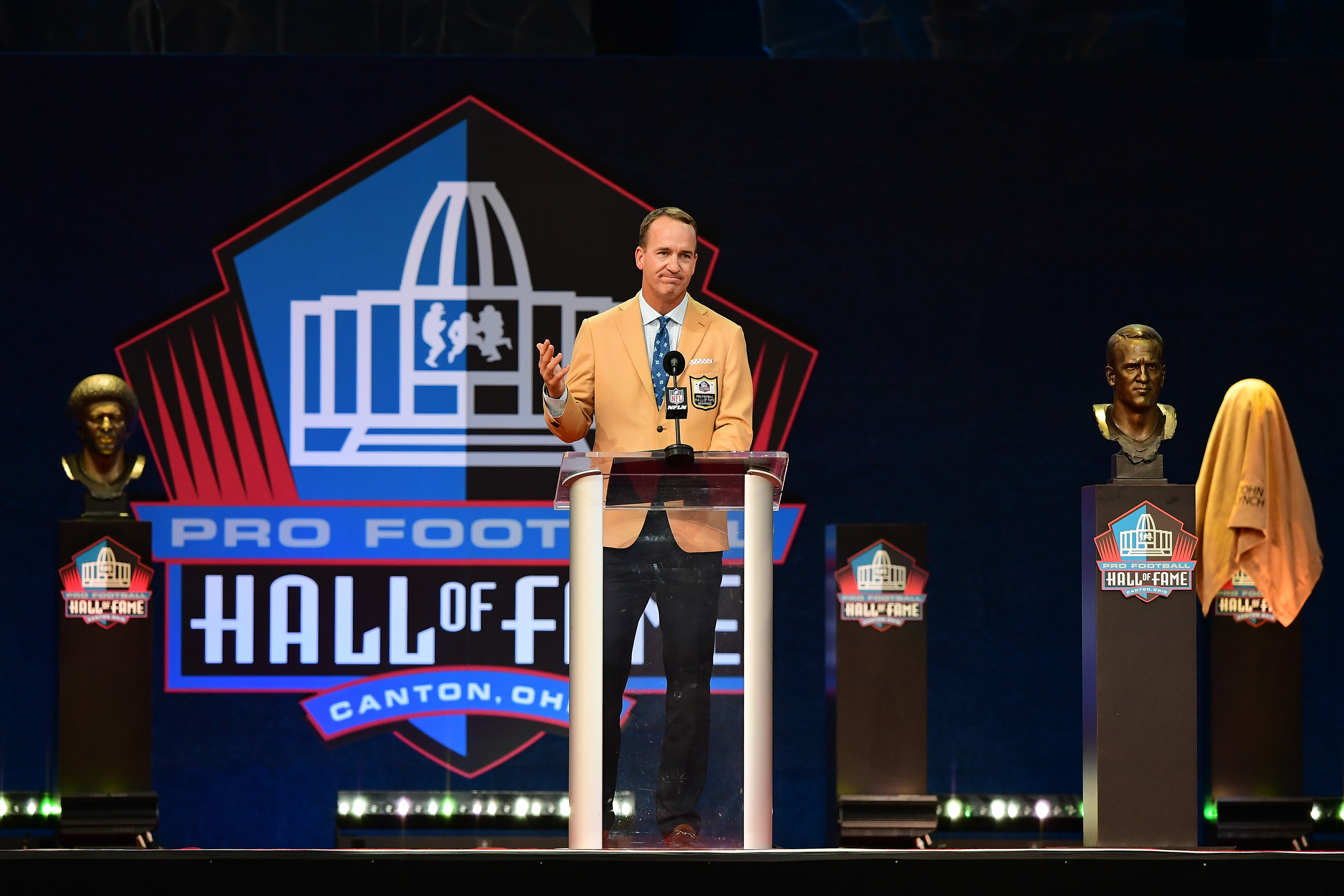 Peyton Manning speaks during the NFL Hall of Fame Enshrinement Ceremony at Tom Benson Hall Of Fame Stadium on August 08, 2021 in Canton, Ohio.