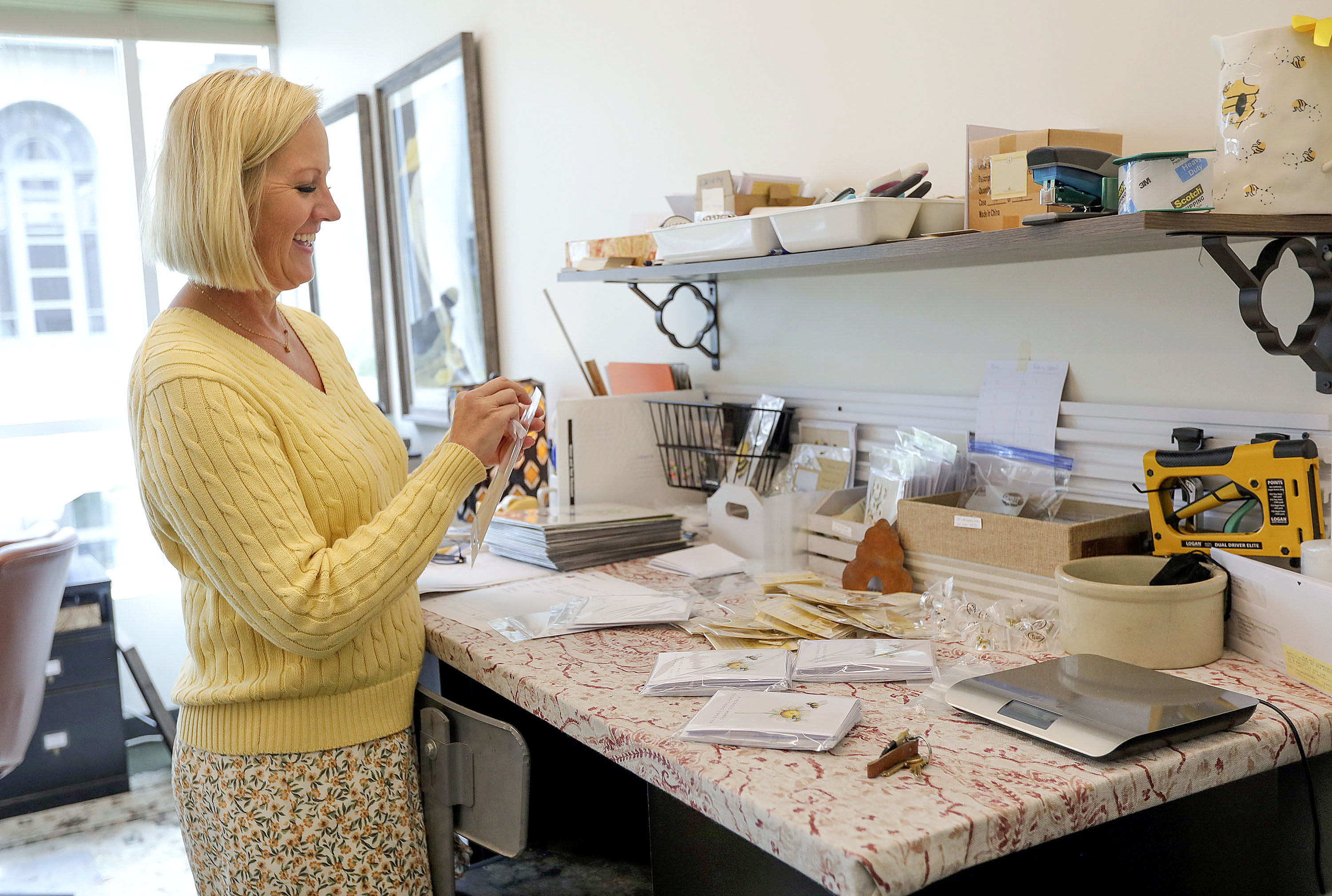 Dena Kennedy, owner of Beehive Shoppe, packs up cards for a customer at her office in downtown Salt Lake City.
