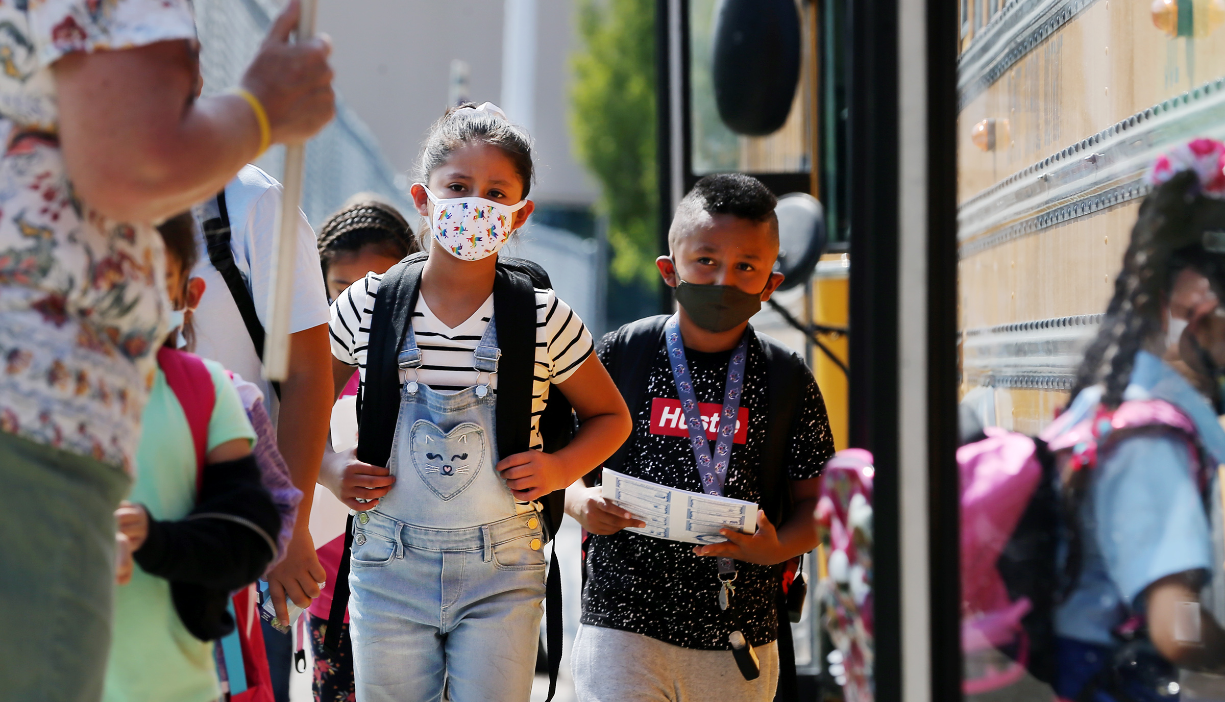 Students at Woodrow Wilson Elementary School in South Salt Lake wear masks as they get on a bus to go home after their first day of school on Aug. 24, 2020.