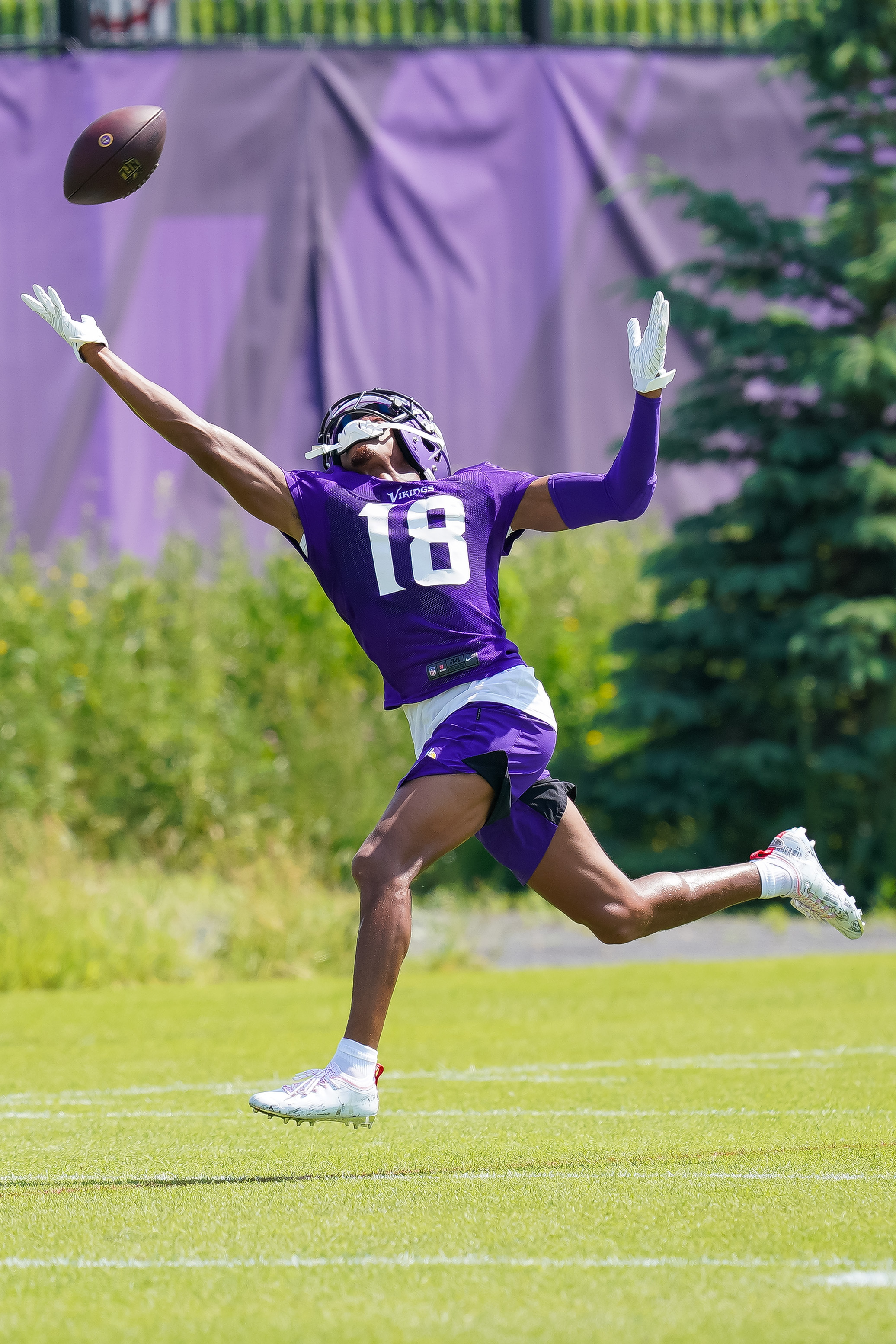 Minnesota Vikings wide receiver Justin Jefferson (18) attempts to catch a pass in drills at OTA at TCO Performance Center.