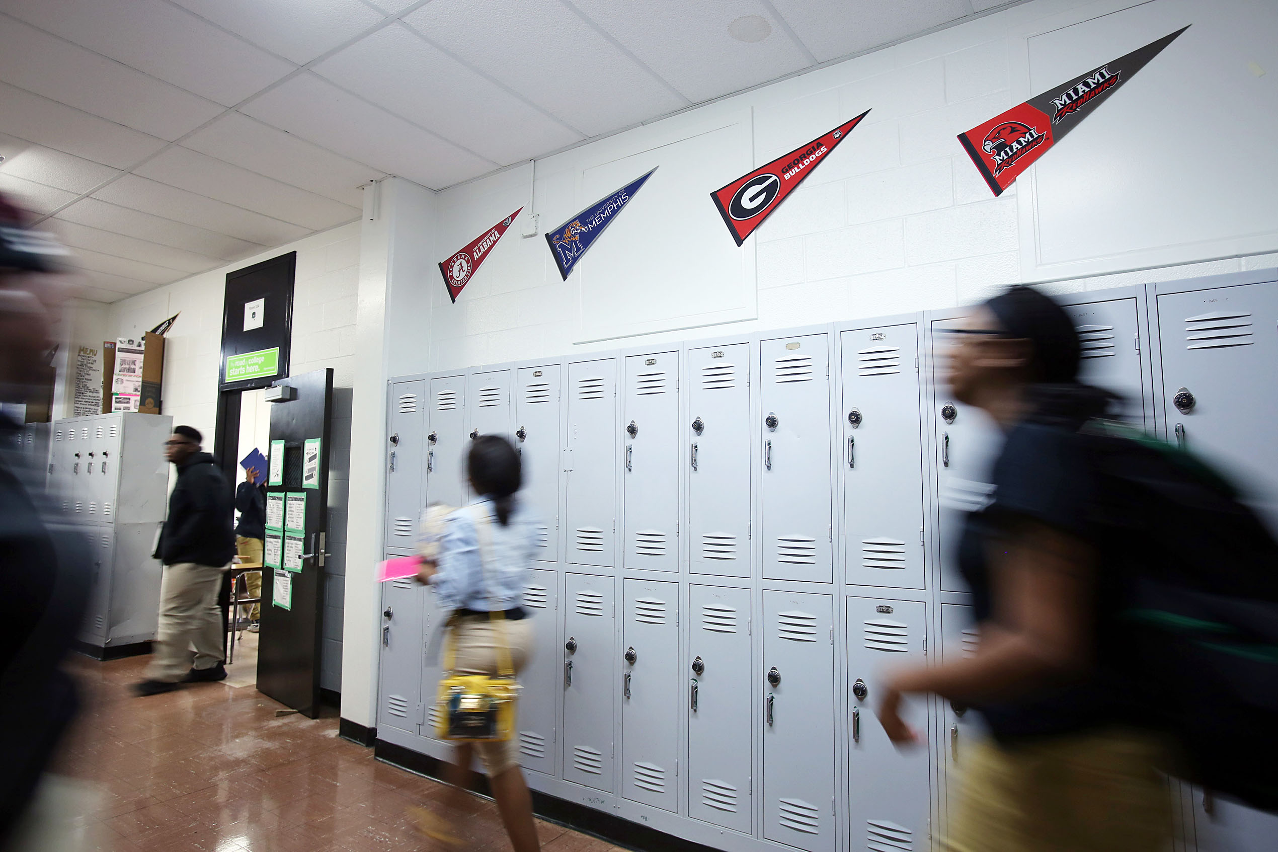 Students walk in a hallway past lockers at a Green Dot school in Memphis.