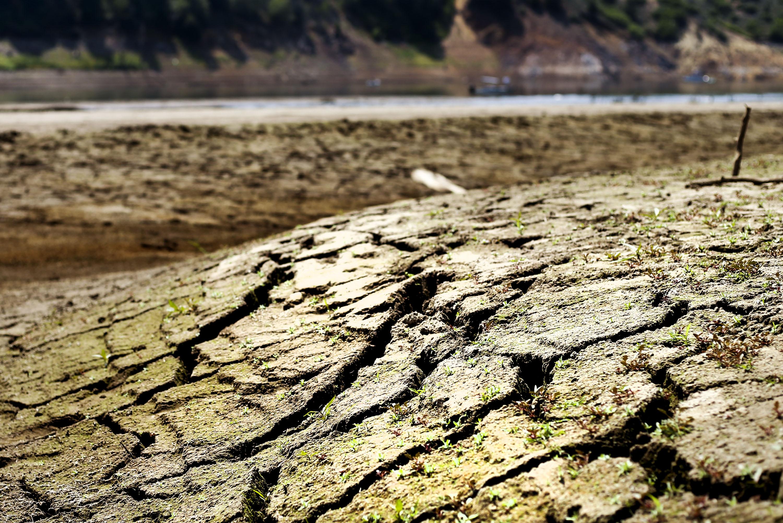 Cracked earth is seen in the waterbed of Jordanelle Reservoir near Kamas,