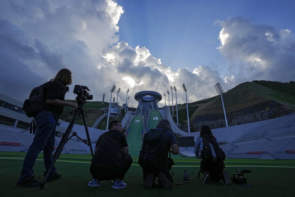 Journalists film the National Ski Jumping Centre, one of the venues for the Beijing 2022 Olympic and Paralympic Winter Games.