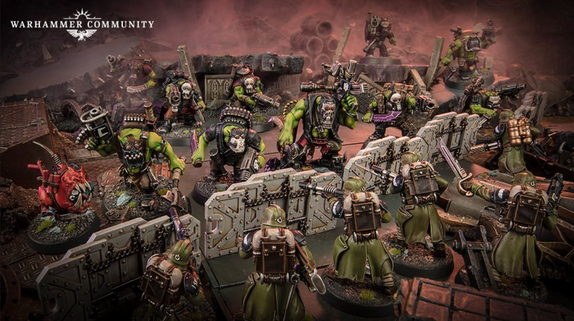 A gunline of Krieg in green holds back an onrushing group of Orks along a barricade. They've brought an explosive animal with them.