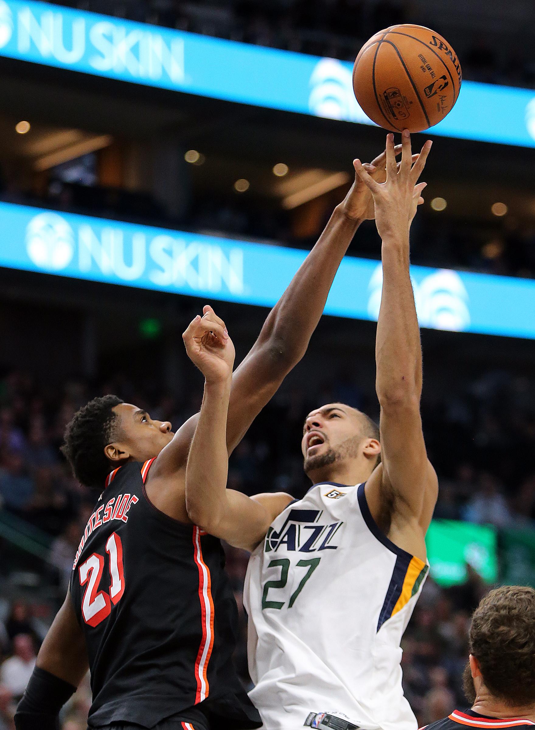 Utah Jazz center Rudy Gobert (27) shoots over Miami Heat center Hassan Whiteside (21).