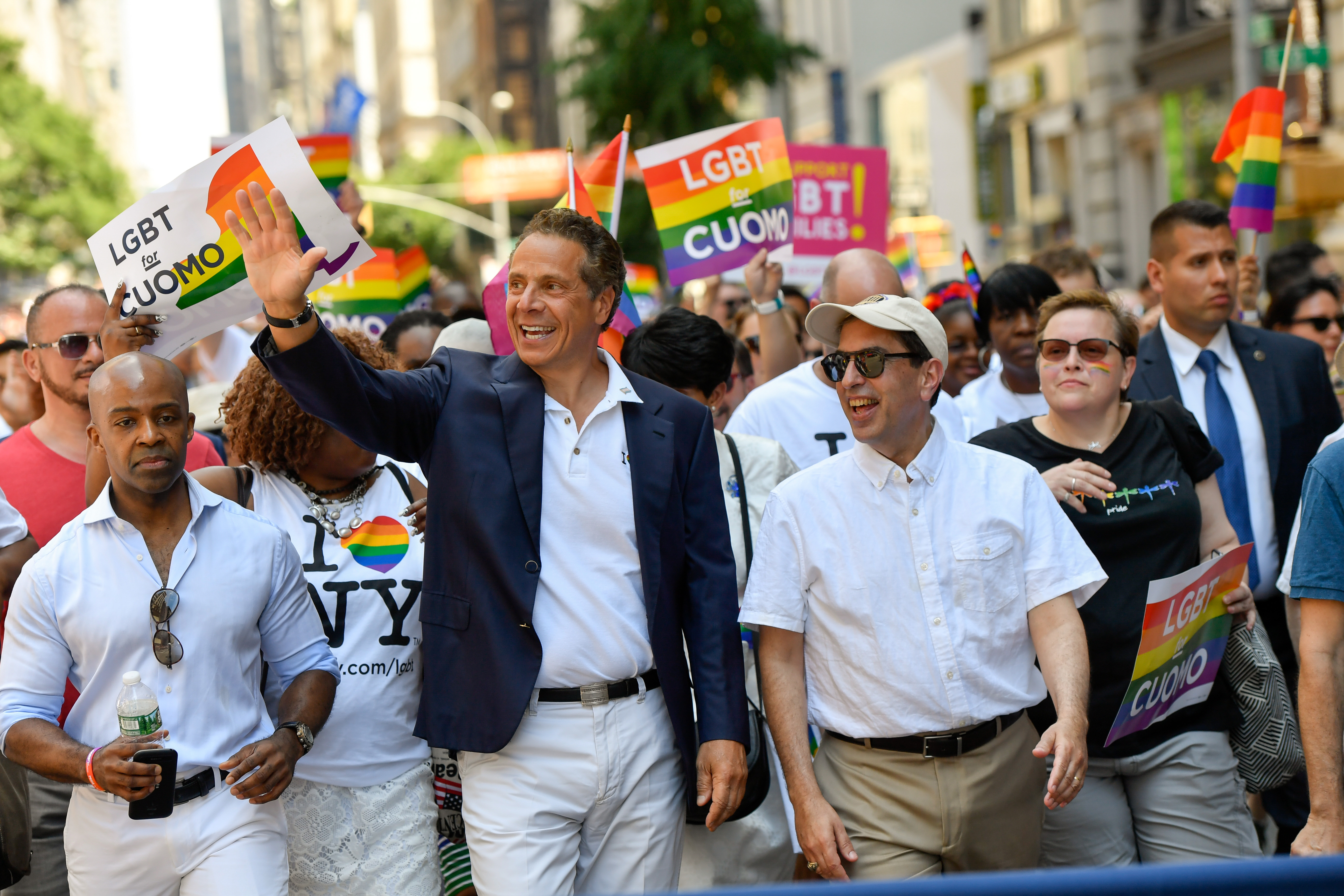 Gov. Andrew Cuomo marches in the 2017 Pride parade in Manhattan with then-counsel Alphonso David at left.